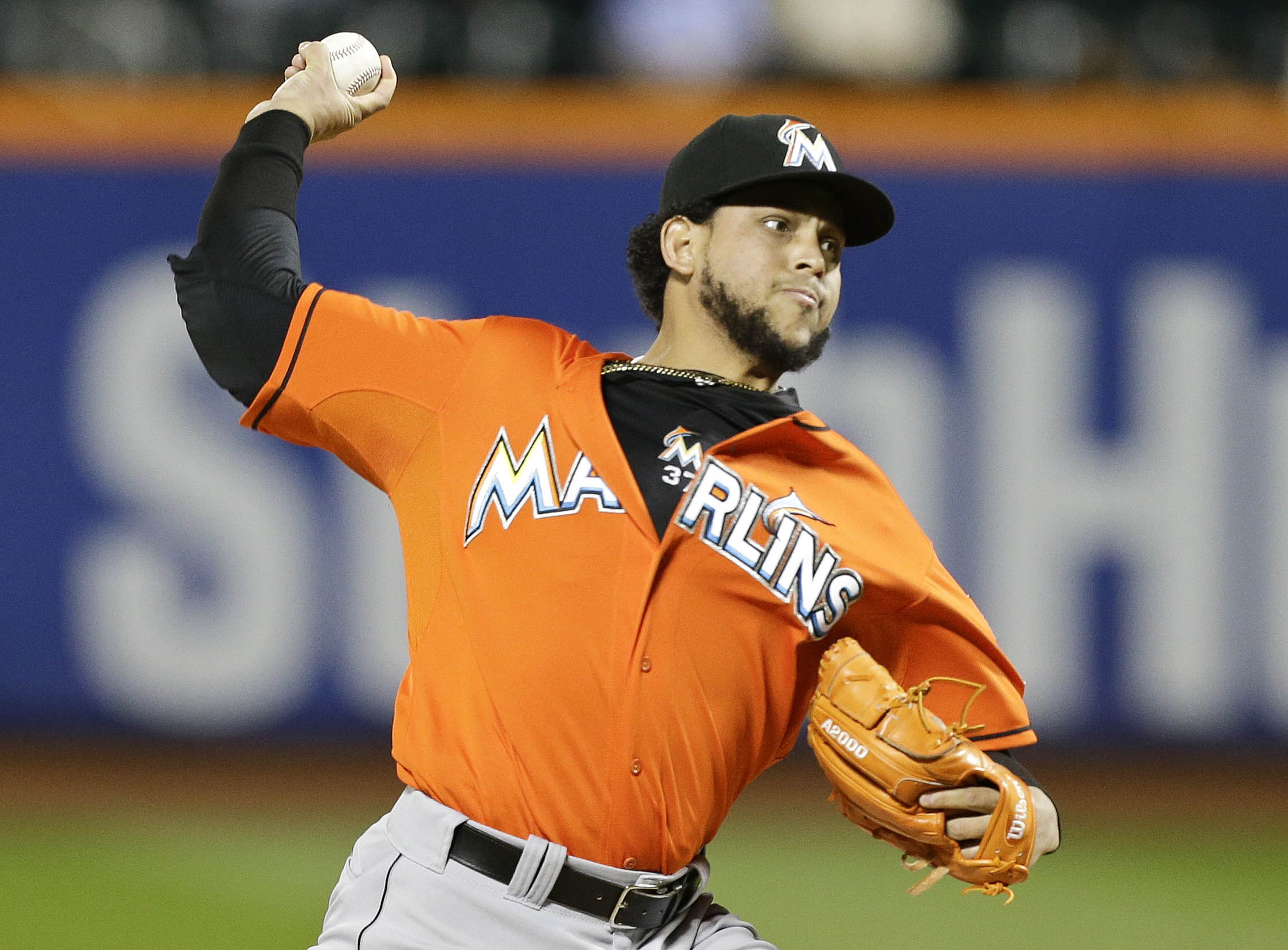 FILE - In this Wednesday, Sept. 17, 2014 file photo, Miami Marlins' Henderson Alvarez delivers a pitch during the first inning of a baseball game against the New York Mets in New York. The Oakland Athletics and pitcher Henderson Alvarez have agreed to a o