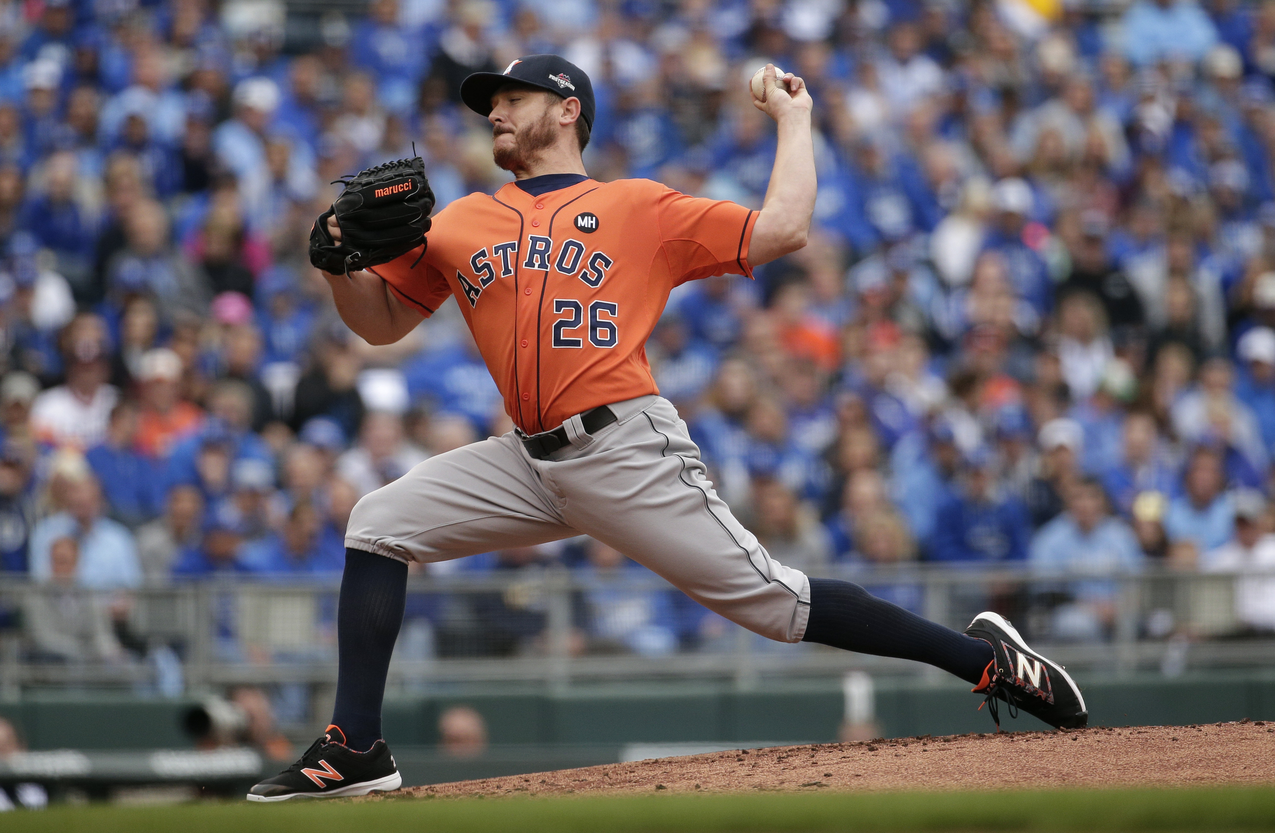 Houston Astros starting pitcher Scott Kazmir throws during the first inning of Game 2 in baseball's American League Division Series against the Kansas City Royals, Friday, Oct. 9, 2015, in Kansas City, Mo. (AP Photo/Charlie Riedel)