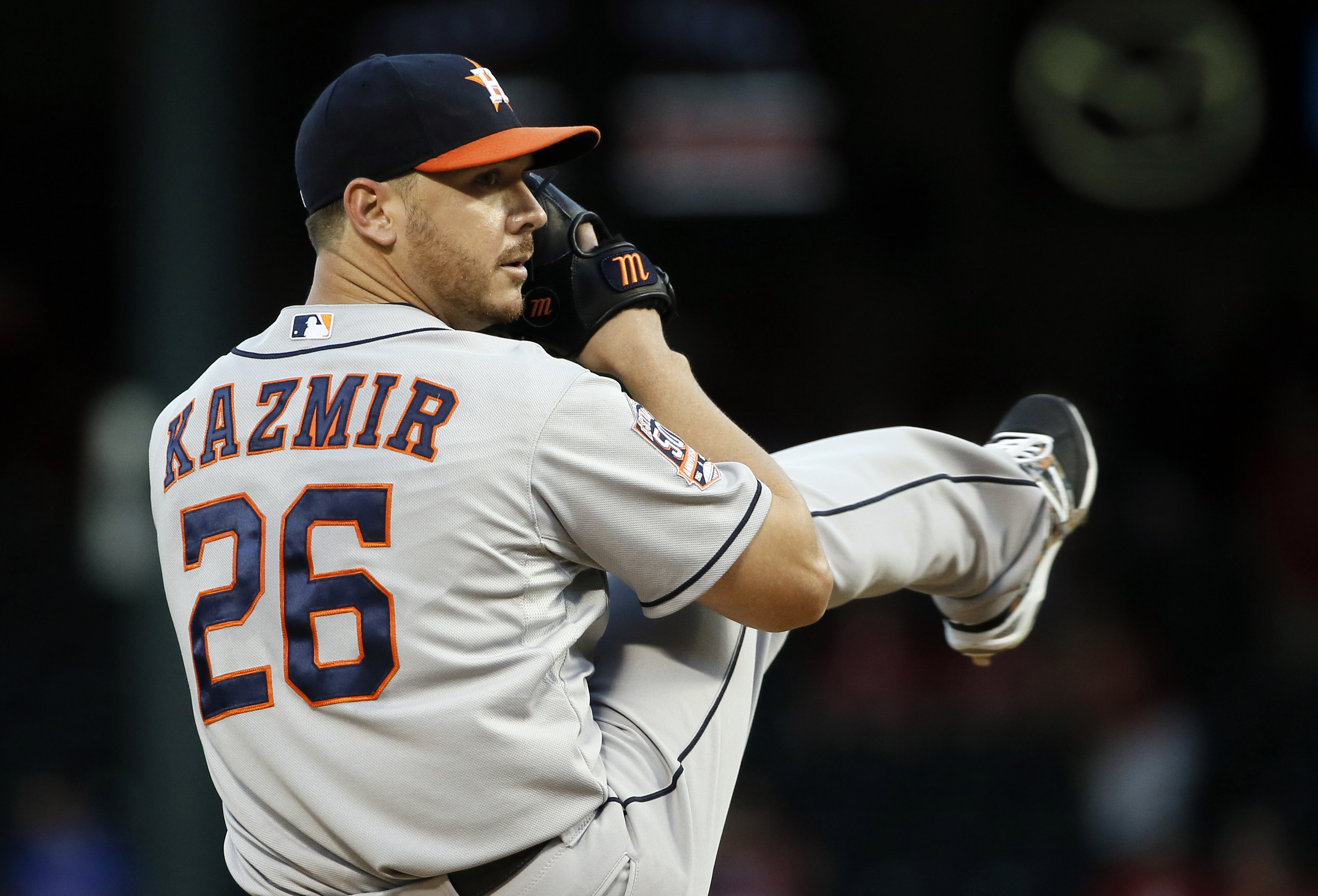 FILE - In this Sept. 14, 2015, file photo, Houston Astros starting pitcher Scott Kazmir (26) works against the Texas Rangers during a baseball game in Arlington, Texas. Kazmir has agreed to a three-year contract with the Los Angeles Dodgers, in a deal ann