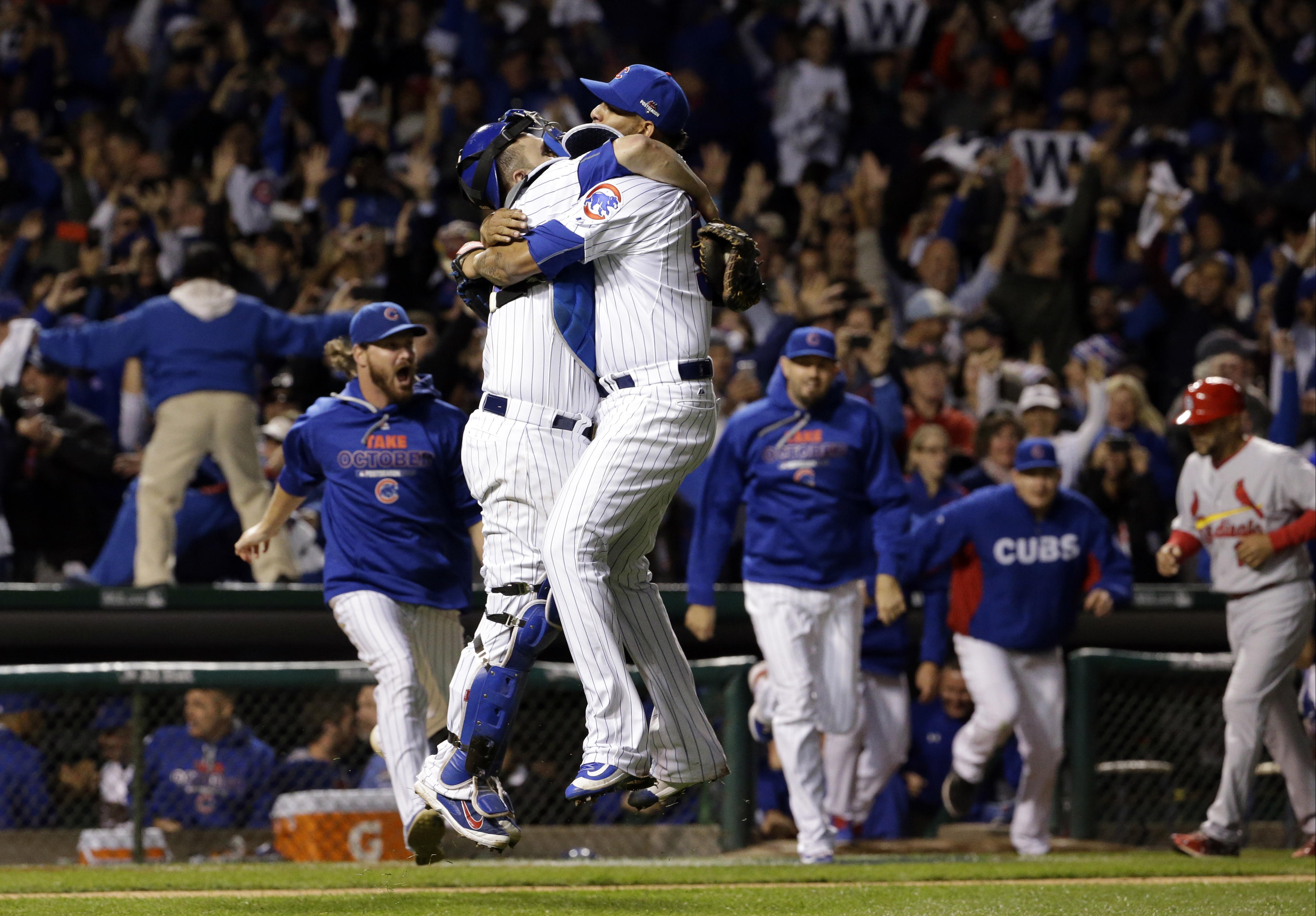 FILE - In this Oct. 13, 2015, file photo, Chicago Cubs catcher Miguel Montero (47) and relief pitcher Hector Rondon (56) celebrate after winning Game 4 in baseball's National League Division Series in Chicago. And while we hate draining the suspense from
