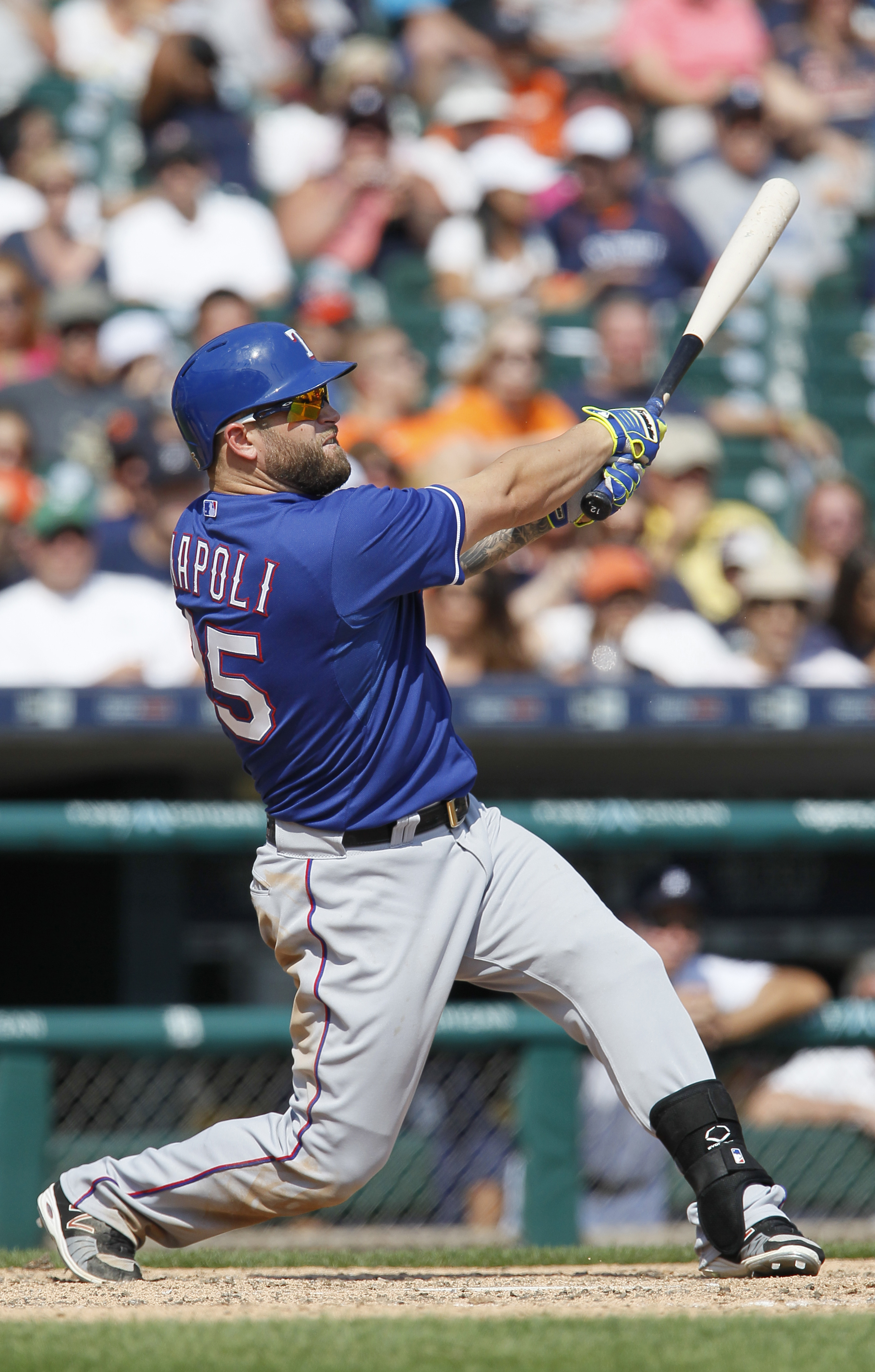 FILE - In this Aug. 23, 2015, file photo, Texas Rangers' Mike Napoli hits a solo home run against the Detroit Tigers during the eighth inning of a baseball game at Comerica Park, in Detroit. Free agent slugger Mike Napoli and the Cleveland Indians have fi