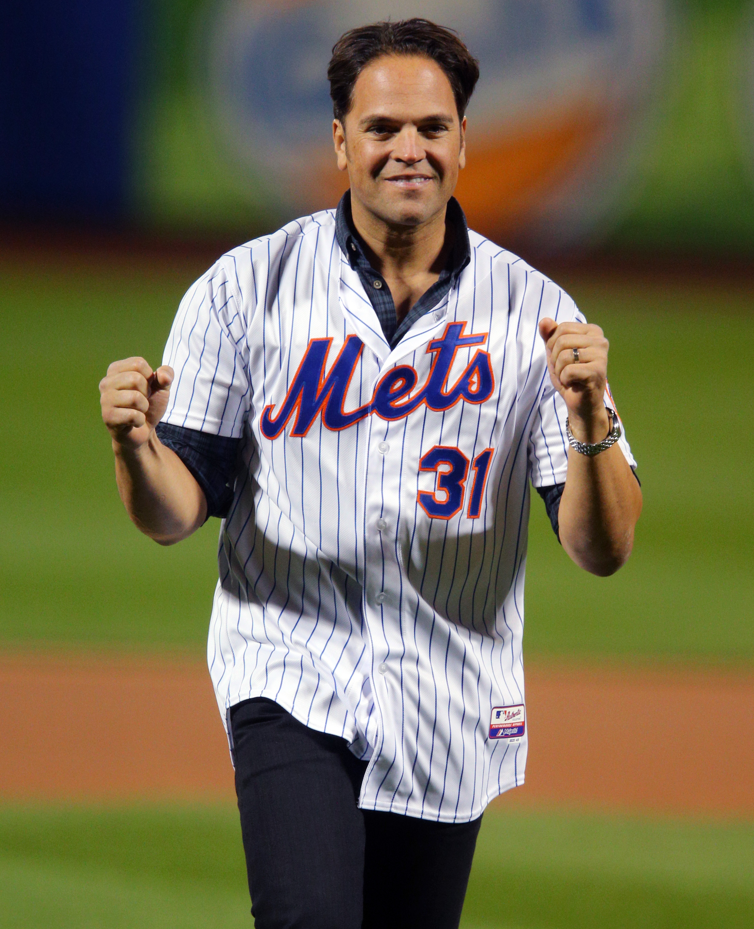 FILE - In this Oct. 30, 2015, file photo, former New York Mets' Mike Piazza throws out the first pitch before Game 3 of the Major League Baseball World Series against the Kansas City Royals, in New York. Ken Griffey Jr. seems assured of election to the Ba