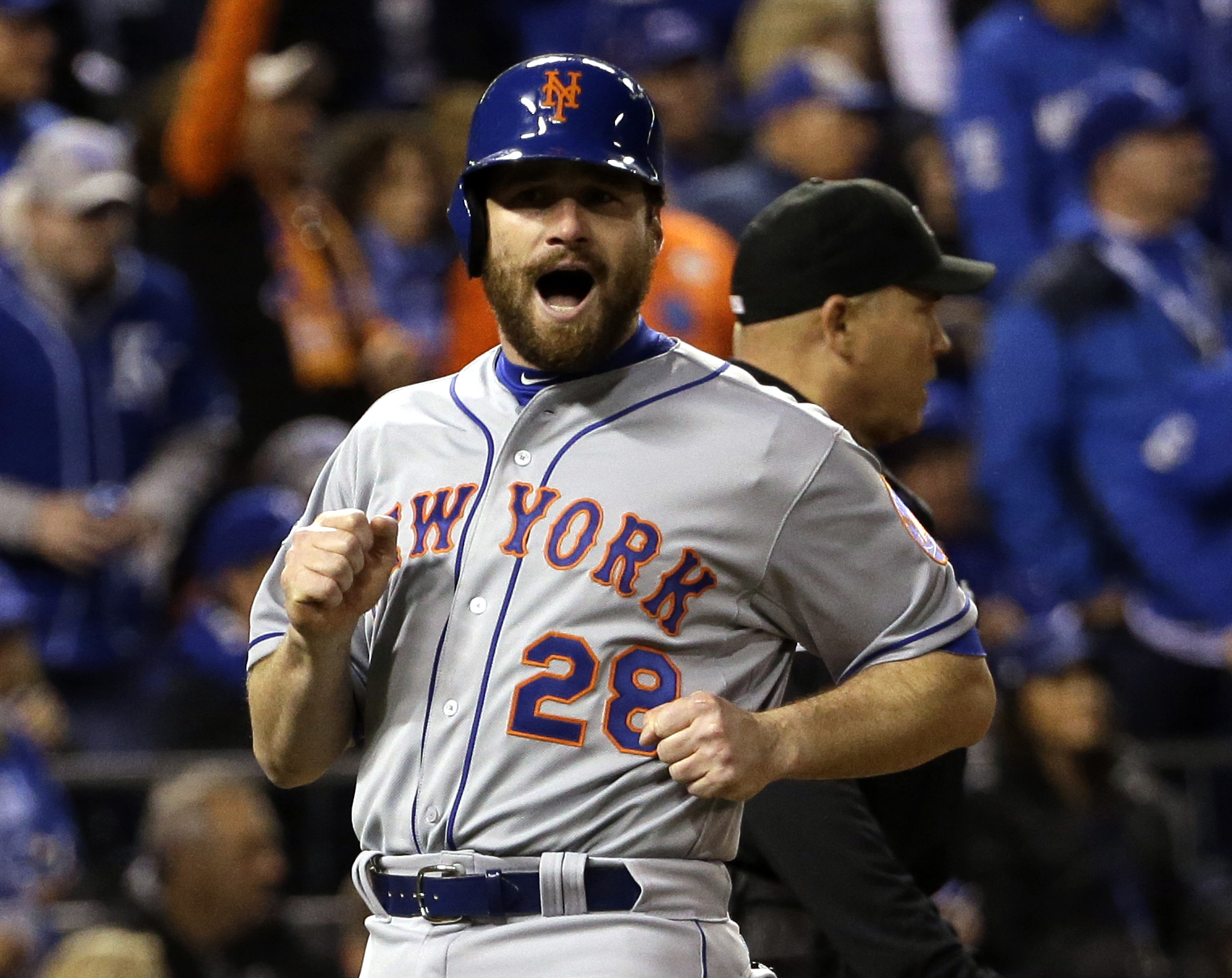 FILE - In this Oct. 28, 2015 file photo, New York Mets' Daniel Murphy reacts as he scores in Game 2 of the Major League Baseball World Series against the Kansas City Royals,  in Kansas City, Mo. On Wednesday, Jan. 6, 2016, The Washington Nationals agreed