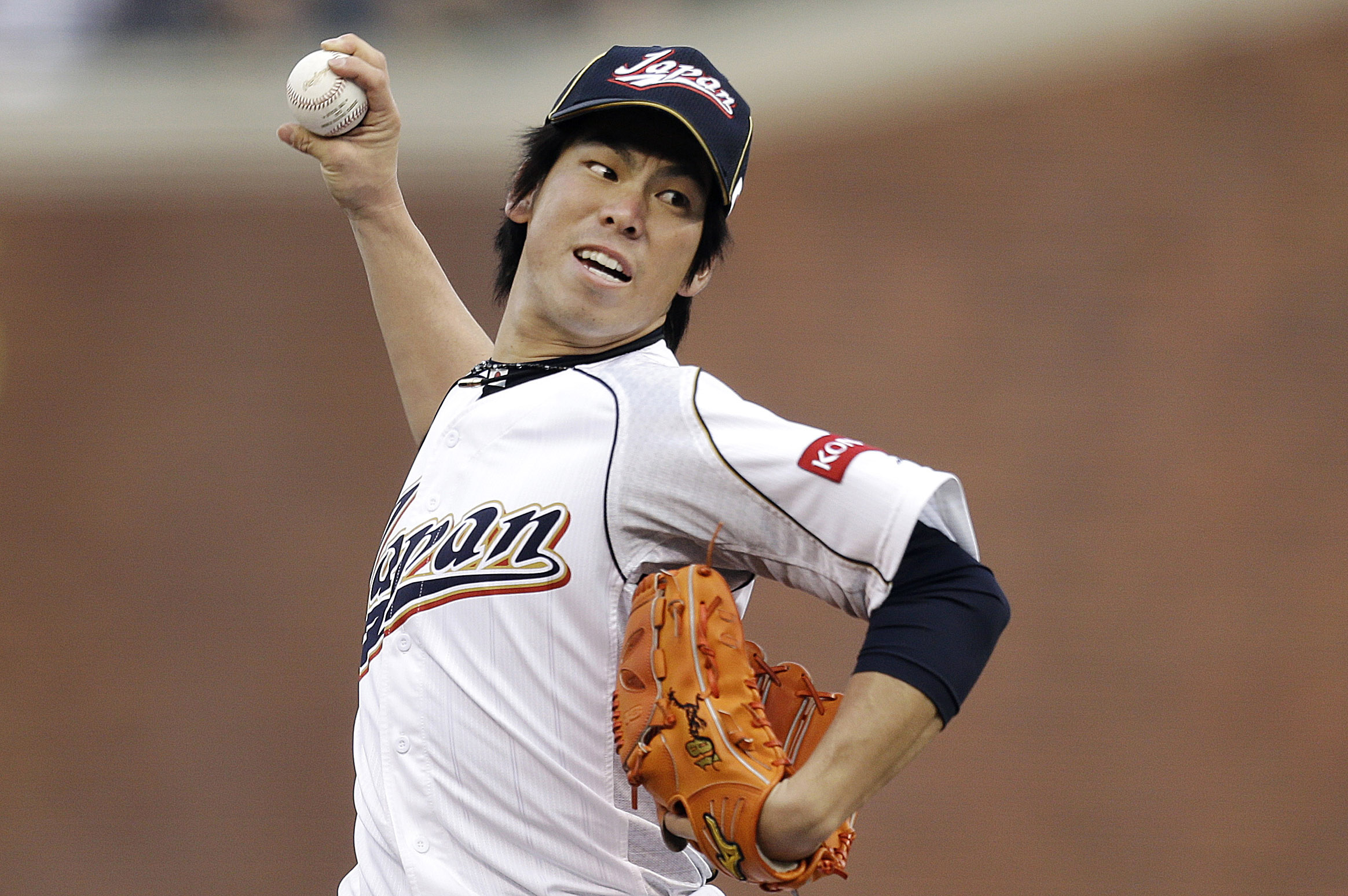 FILE - In this Sunday, March 17, 2013 file photo, Japan's Kenta Maeda pitches during the first inning of a semifinal game of the World Baseball Classic against Puerto Rico in San Francisco. The Dodgers are set to announce the signing of free-agent Japanes
