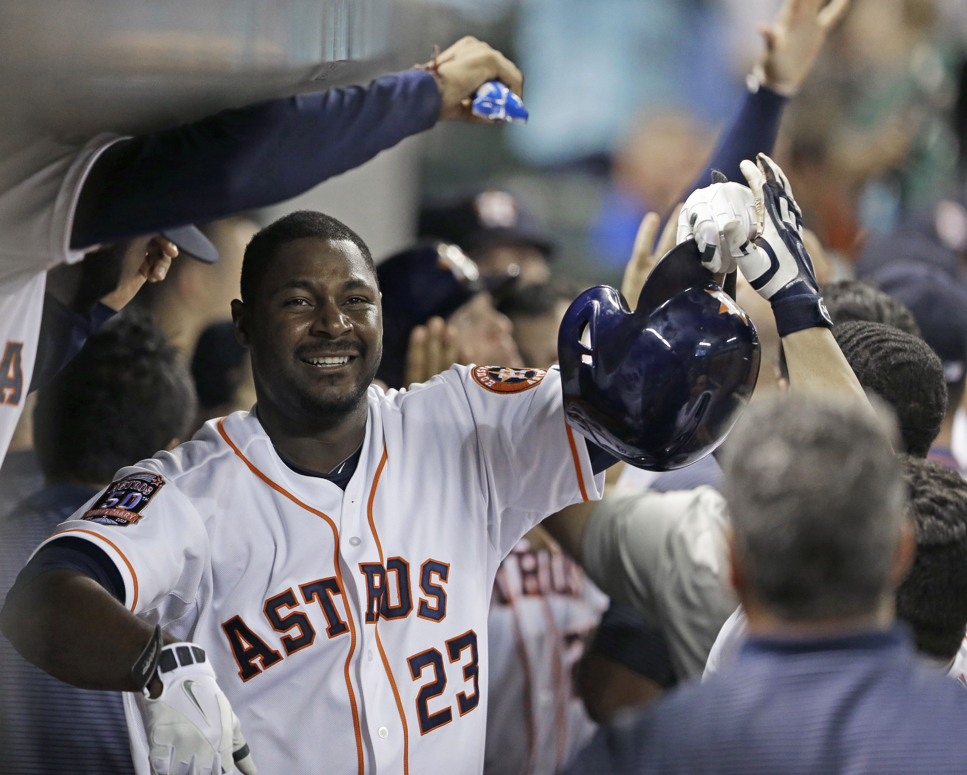 FILE - In this Saturday, May 16, 2015 file photo, Houston Astros' Chris Carter (23) is congratulated in the dugout after hitting a three-run home run against the Toronto Blue Jays in the sixth inning of a baseball game in Houston. Free-agent first baseman