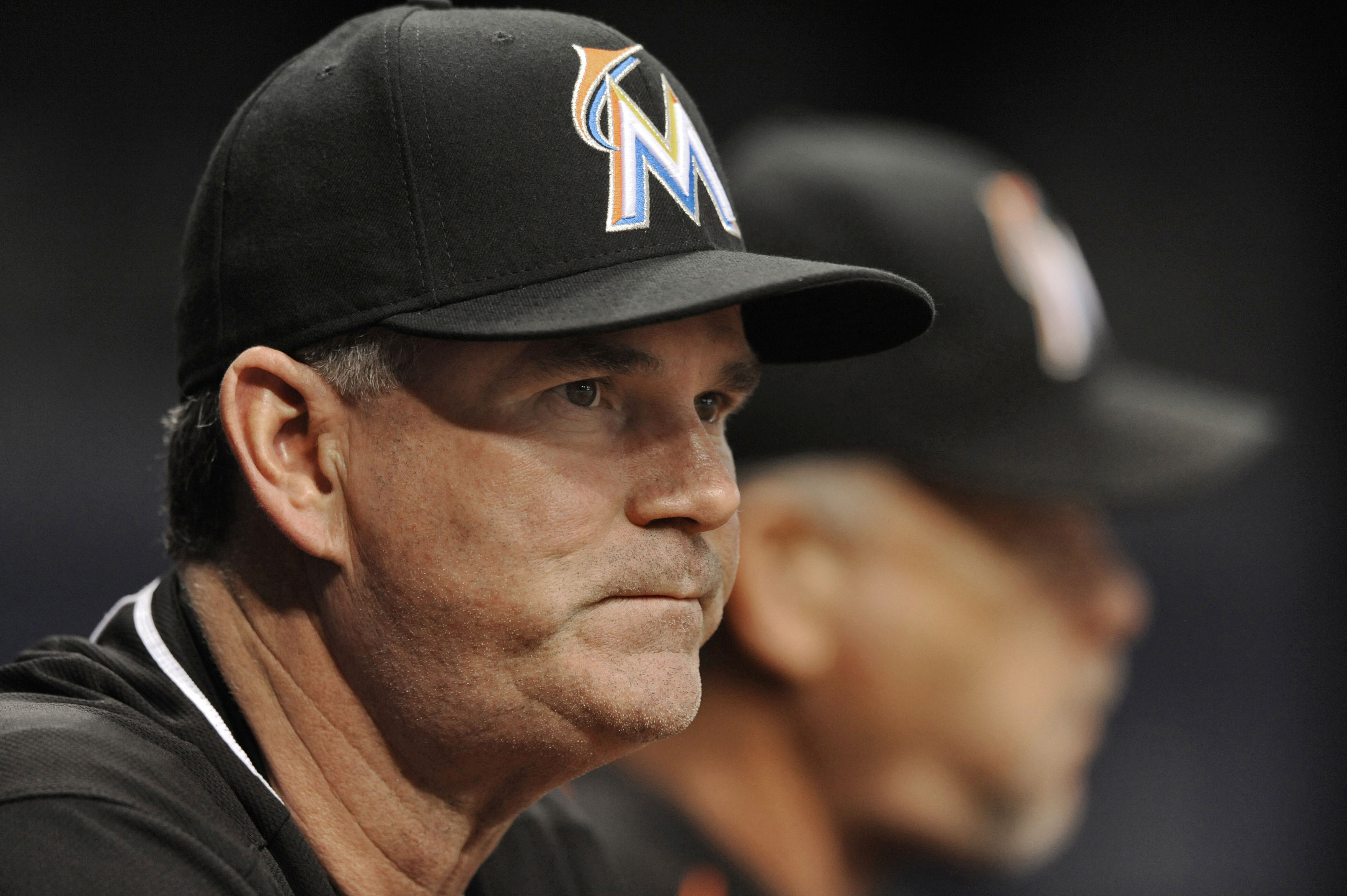 FILE - In this Oct. 1, 2015 file photo, then-Miami Marlins manager Dan Jennings, left, watches his team play the Tampa Bay Rays during the first inning of a baseball game in St. Petersburg, Fla. The Washington Nationals have added Jennings to their front