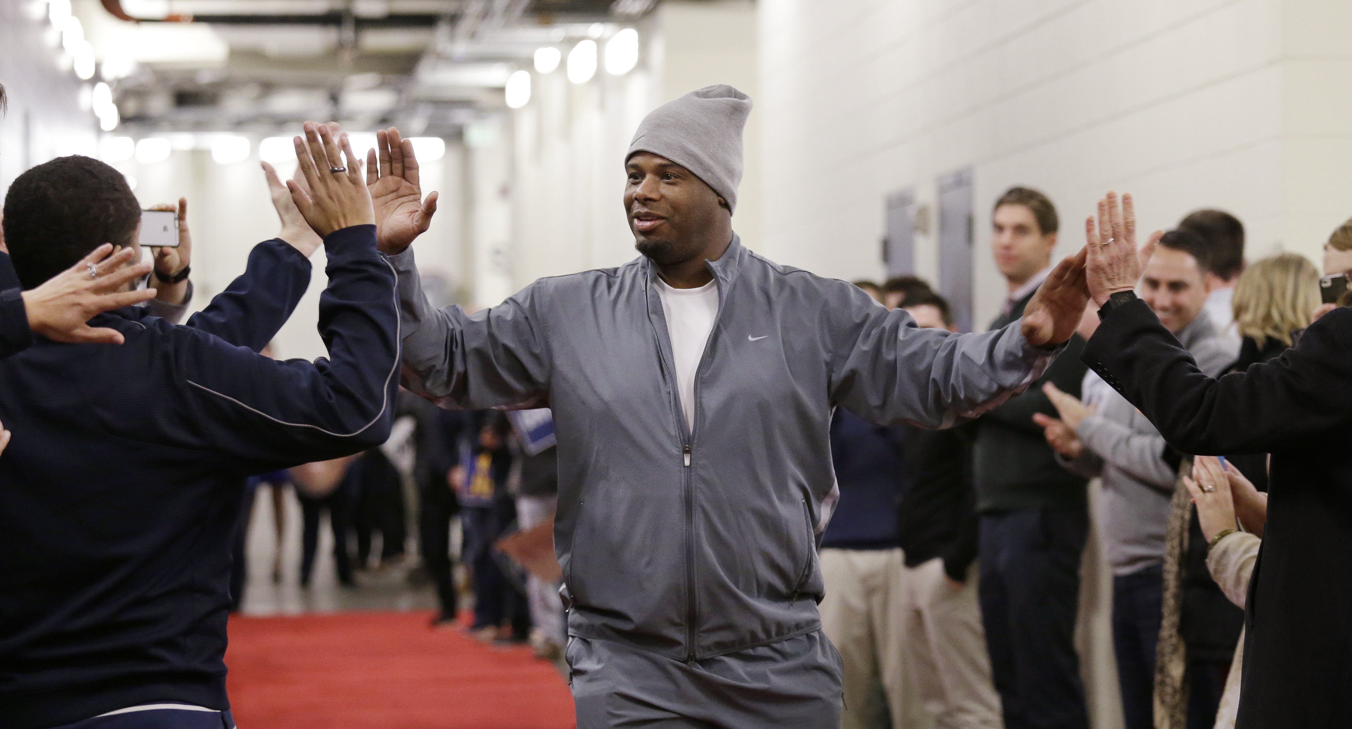 Former Seattle Mariner Ken Griffey Jr. is greeted by team staff members on his arrival before a news conference Friday, Jan. 8, 2016, in Seattle. Griffey's Hall of Fame whirlwind came back to where it all started, when he spoke at Safeco Field, the stadiu