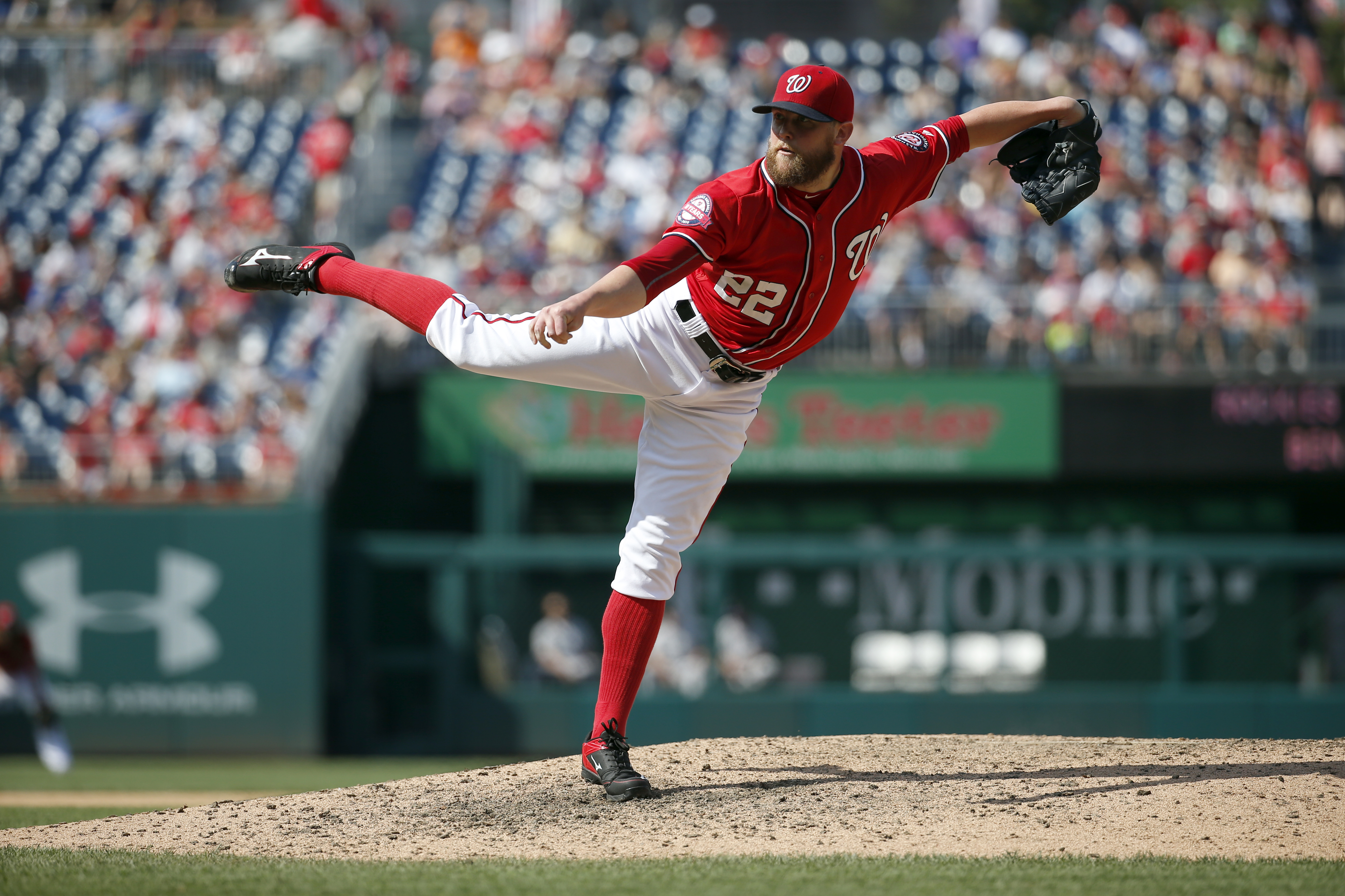 Washington Nationals relief pitcher Drew Storen (22) throws during the eighth inning of a baseball game against the Colorado Rockies at Nationals Park, Sunday, Aug. 9, 2015, in Washington. The Rockies won 6-4. (AP Photo/Alex Brandon)