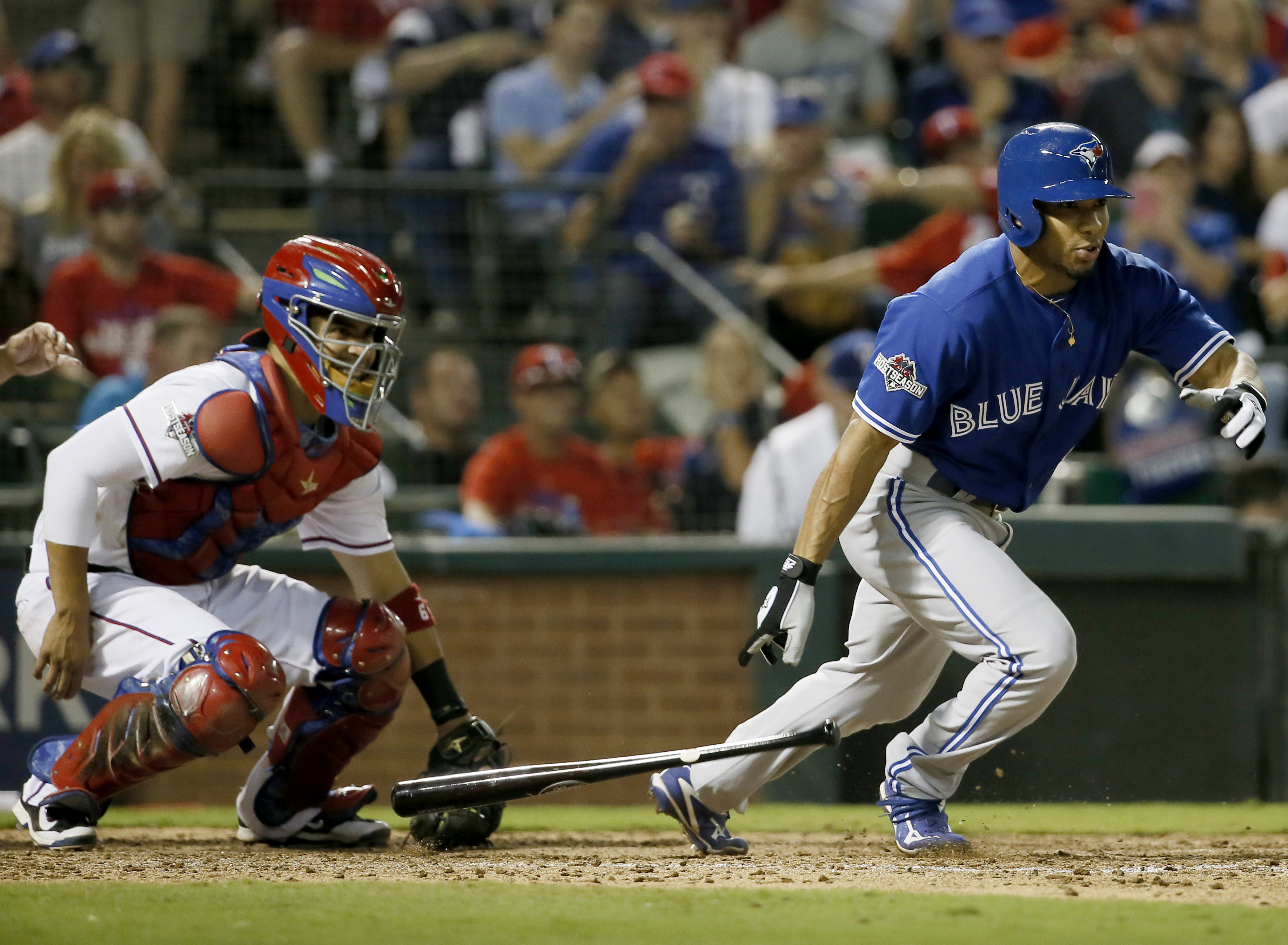 FILE - In this Oct. 11, 2015, file photo, Toronto Blue Jays' Ben Revere, right, singles against the Texas Rangers during the seventh inning in Game 3 of baseball's American League Division Series in Arlington, Texas. The Washington Nationals accommodated