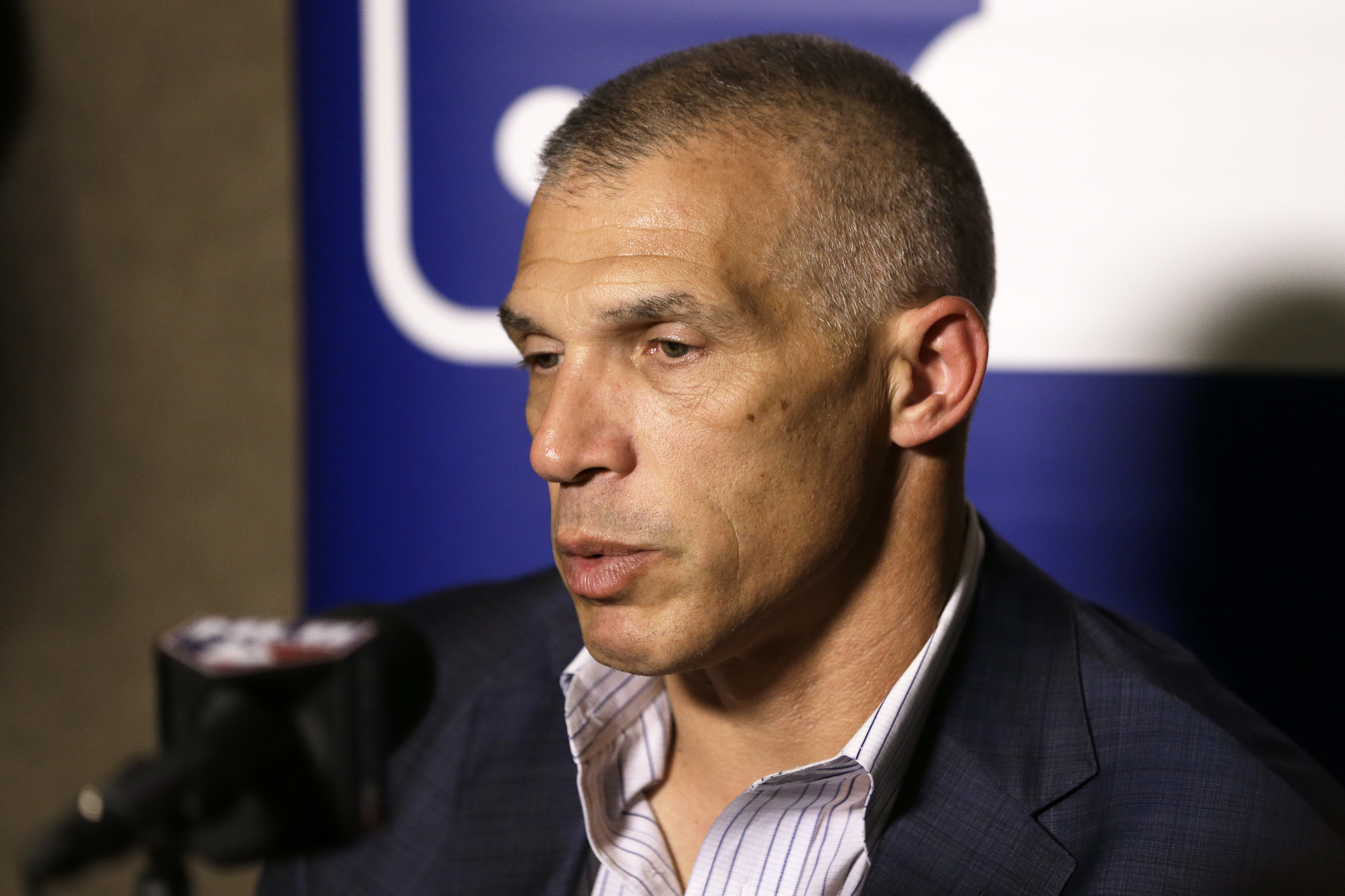 FILE - This Dec. 8, 2015 file photo shows New York Yankees manager Joe Girardi talking with reporters at the Major League Baseball winter meetings in Nashville, Tenn. Girardi said, Monday, Jan. 11, 2016, newly acquired left-hander Aroldis Chapman will go