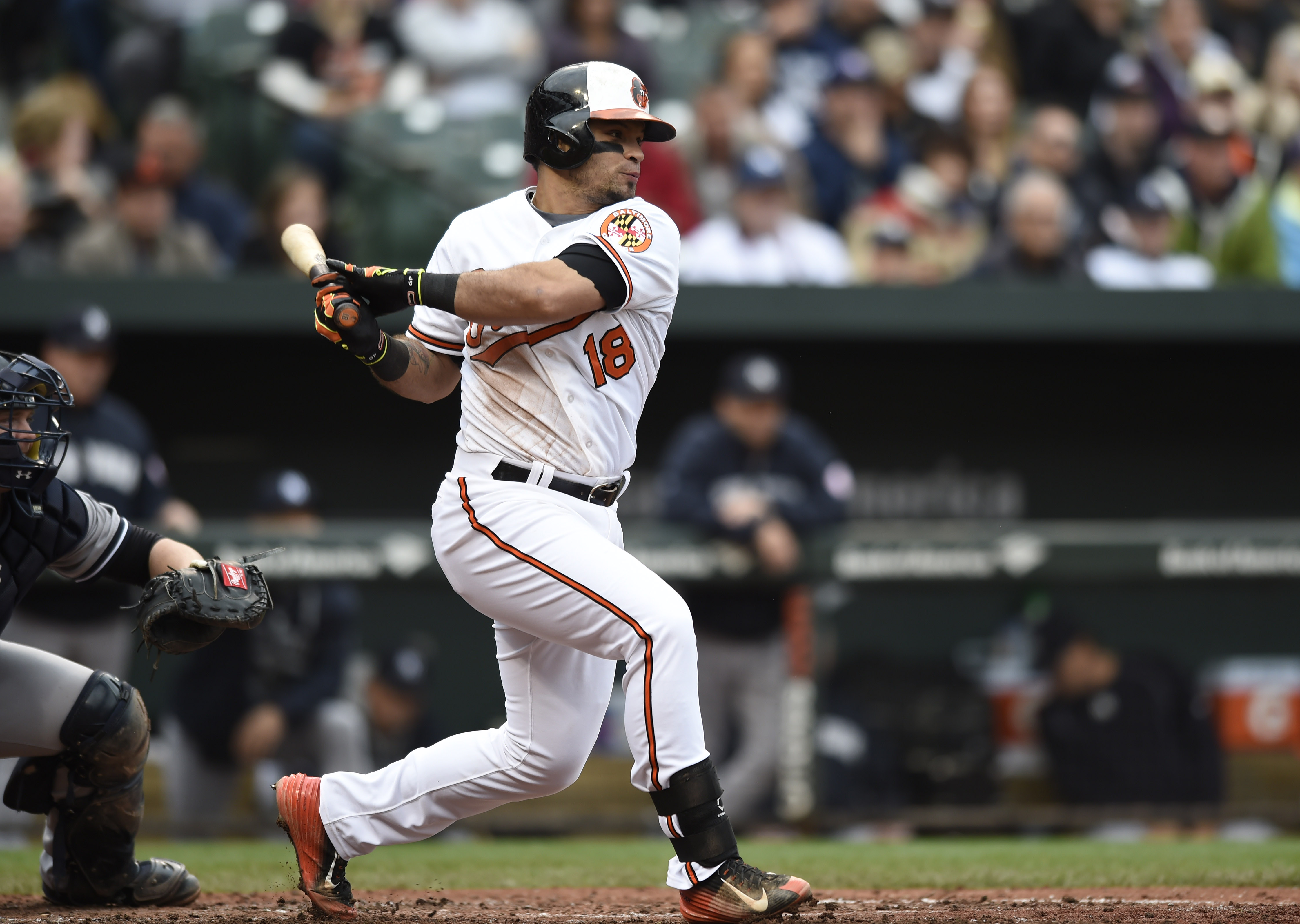 Baltimore Orioles' Gerardo Parra follows through on a two-run single against the New York Yankees in the fourth inning of a baseball game in Baltimore, Sunday, Oct. 4, 2015. (AP Photo/Gail Burton)