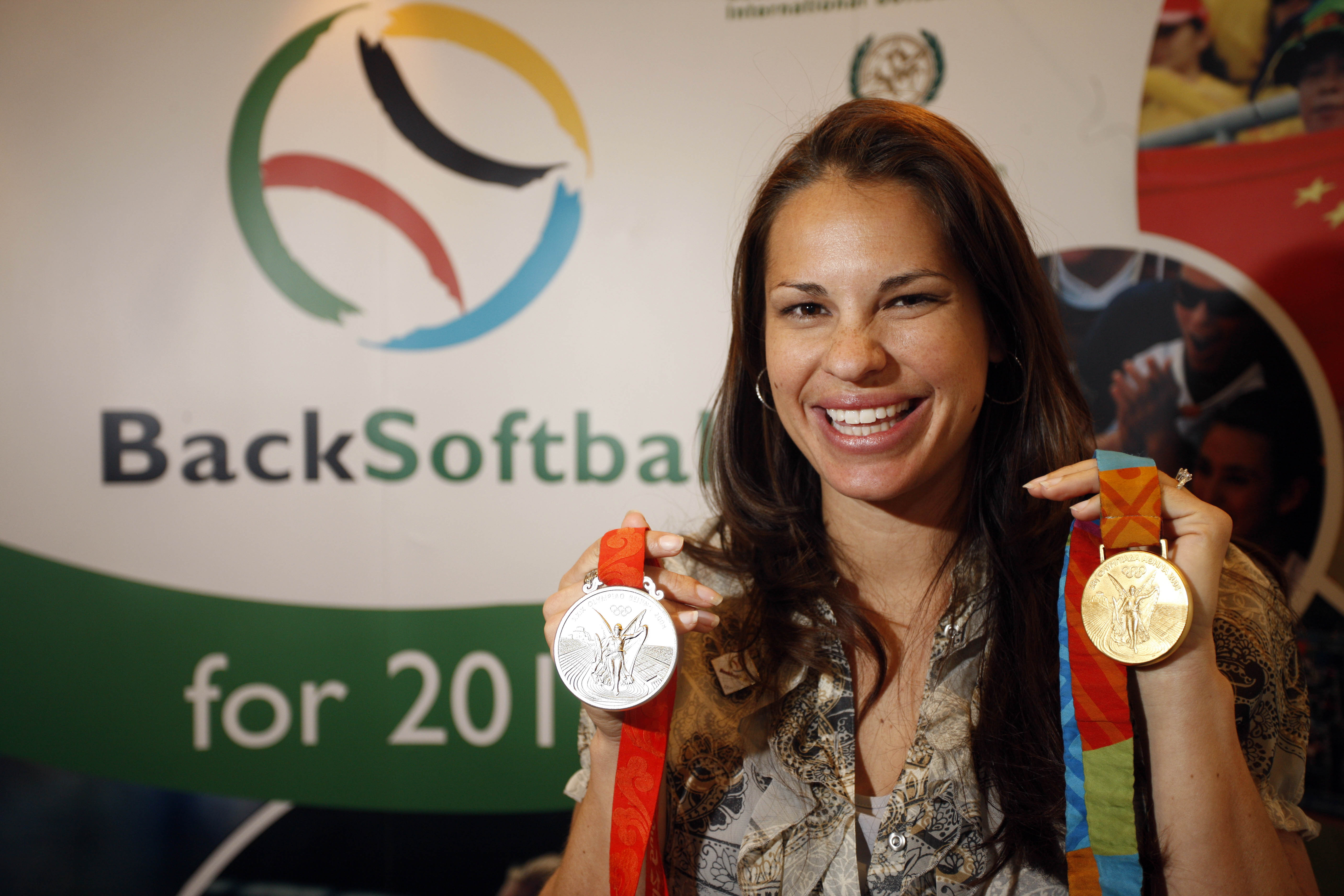 """FILE - This March 25, 2009 file photo shows Olympic softball medalist Jessica Mendoza, of the United States, smiling during the 2009 SportAccord gathering in Denver. Mendoza will stay permanently on """"Sunday Night Baseball"""" in a groundbreaking assignment f"""