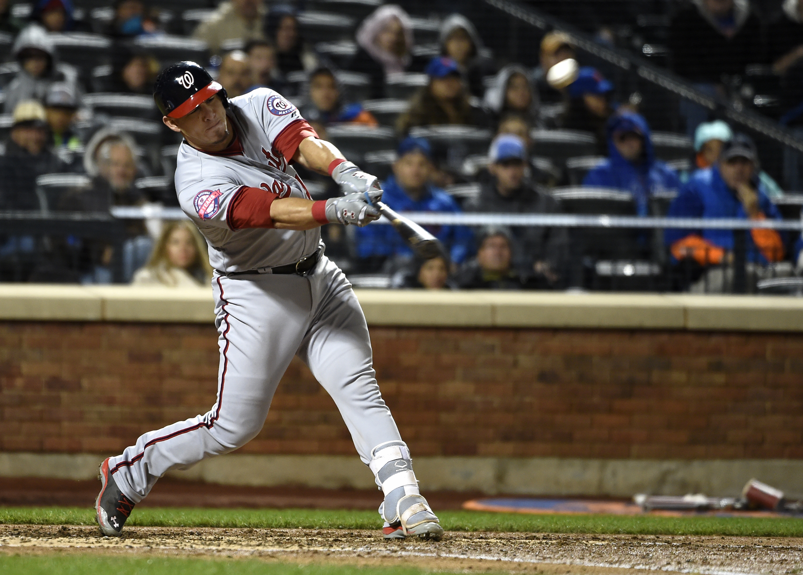 FILE - In this Oct. 3, 2015 file photo, Washington Nationals' Wilson Ramos (40) hits a sacrifice fly off of New York Mets starting pitcher Matt Harvey in the sixth  inning of the second baseball game of a doubleheader, in New York. Ramos agreed to terms o