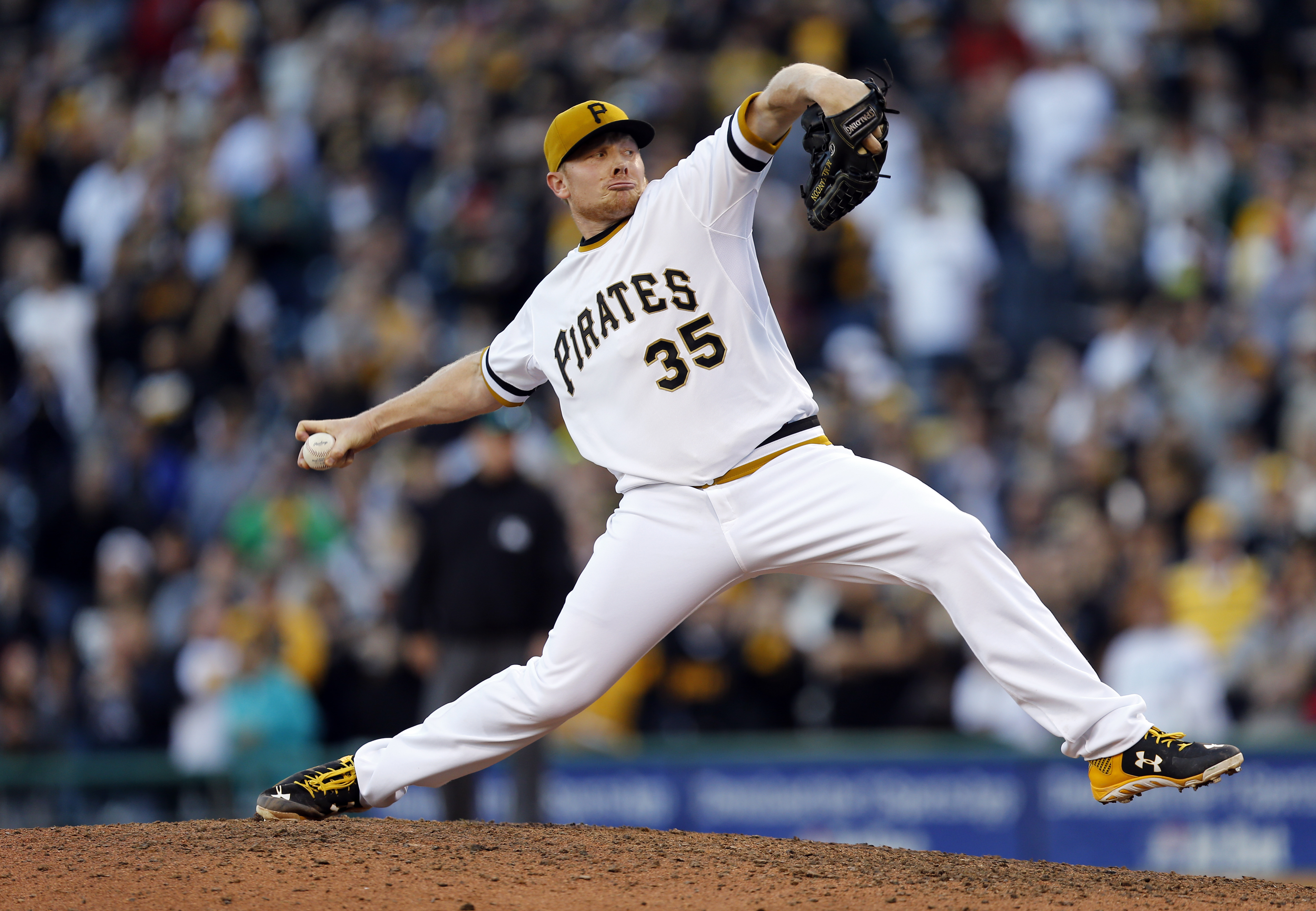 Pittsburgh Pirates relief pitcher Mark Melancon throws against the Cincinnati Reds in the ninth inning of a baseball game, Sunday, Oct. 4, 2015, in Pittsburgh. The Pirates won 4-0 and clenched the home field for their upcoming wild-card playoff game again
