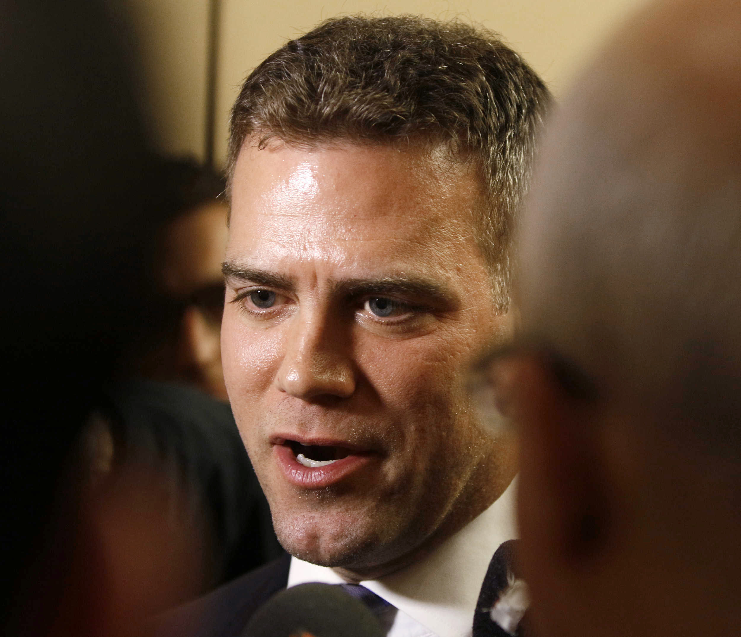 Theo Epstein, Chicago Cubs president of baseball operations, speaks to reporters during the baseball team's convention, Friday, Jan. 15, 2016, in Chicago. (Daniel White/Daily Herald via AP)