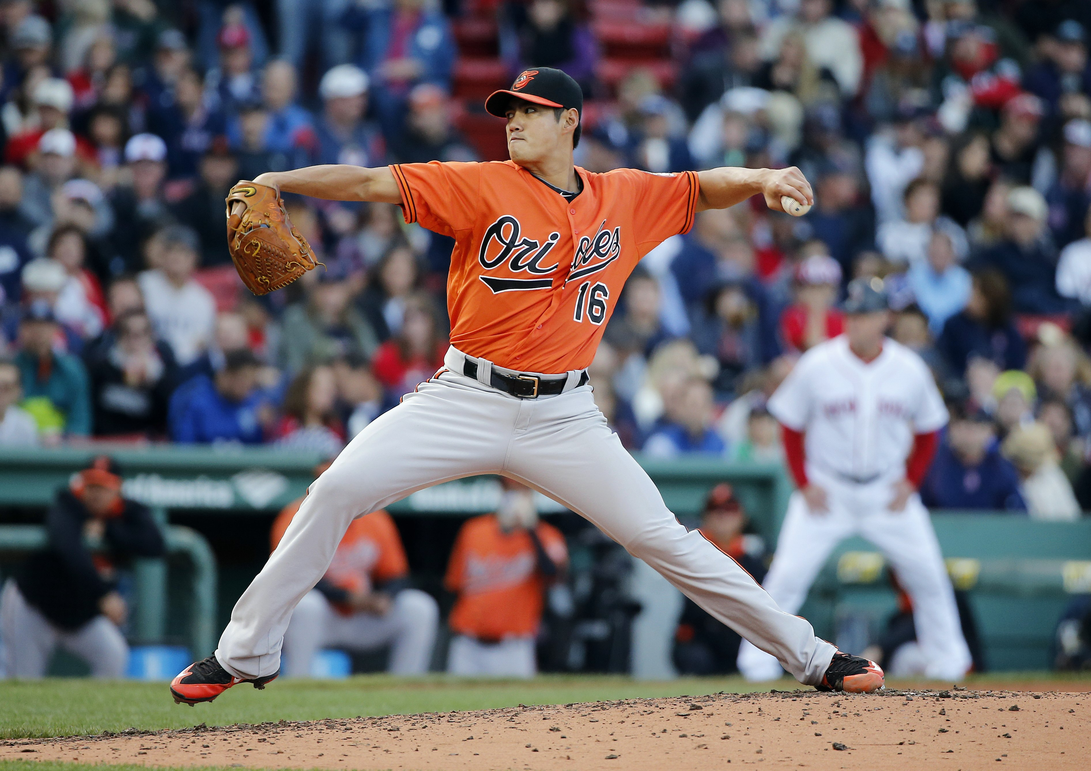 FILE - In this Sept. 26, 2015, file photo, Baltimore Orioles' Wei-Yin Chen pitches during the fourth inning of a baseball game against the Boston Red Sox, in Boston. Left-hander Wei-Yin Chen has finalized an $80 million, five-year contract with the Miami