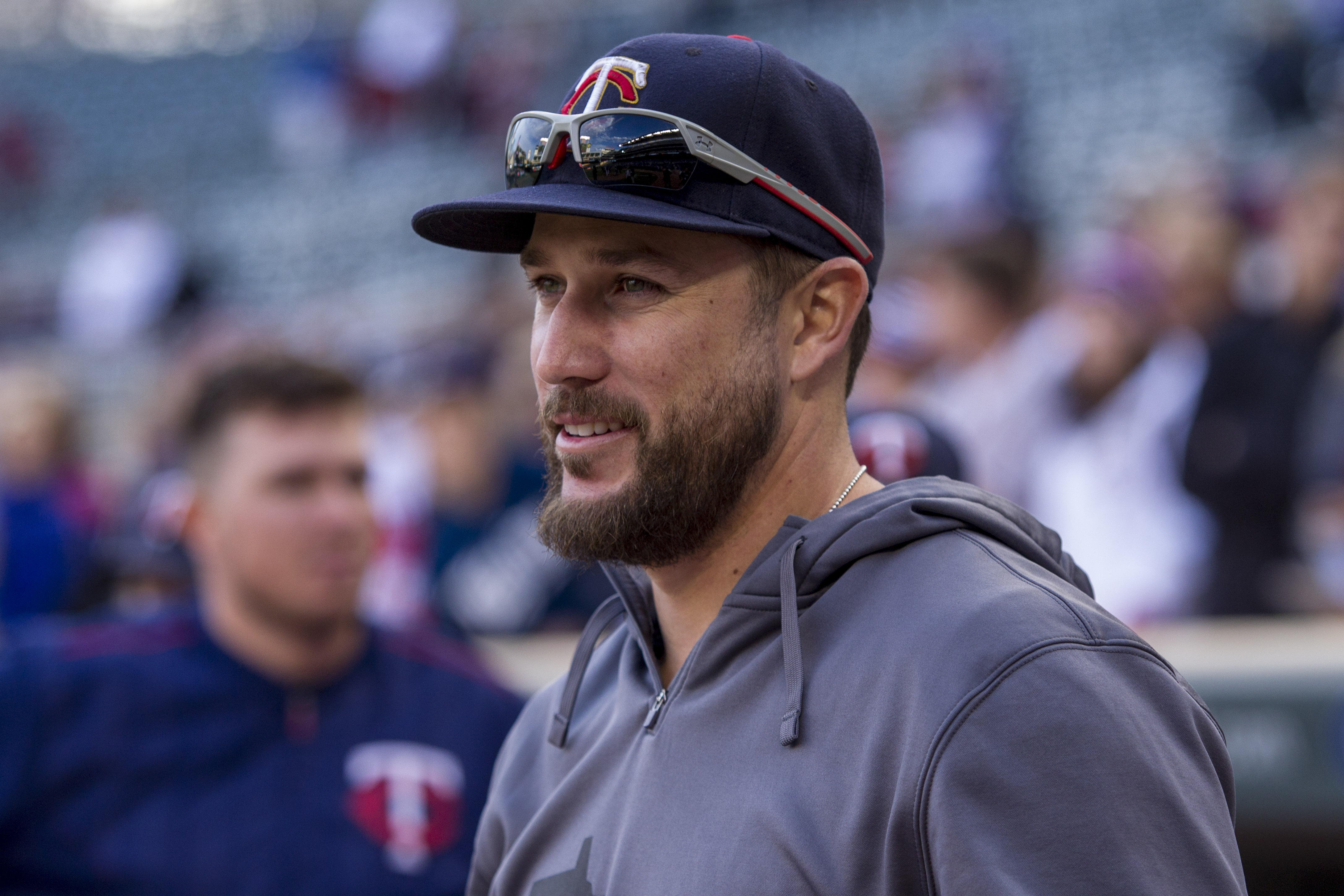 Minnesota Twin Trevor Plouffe waits to meet with a fan who won his jersey after the Twins lost 6-1 to the Kansas City Royals at a baseball game Sunday, Oct. 4, 2015, in Minneapolis. The Royals won 6-1. (AP Photo/Bruce Kluckhohn)