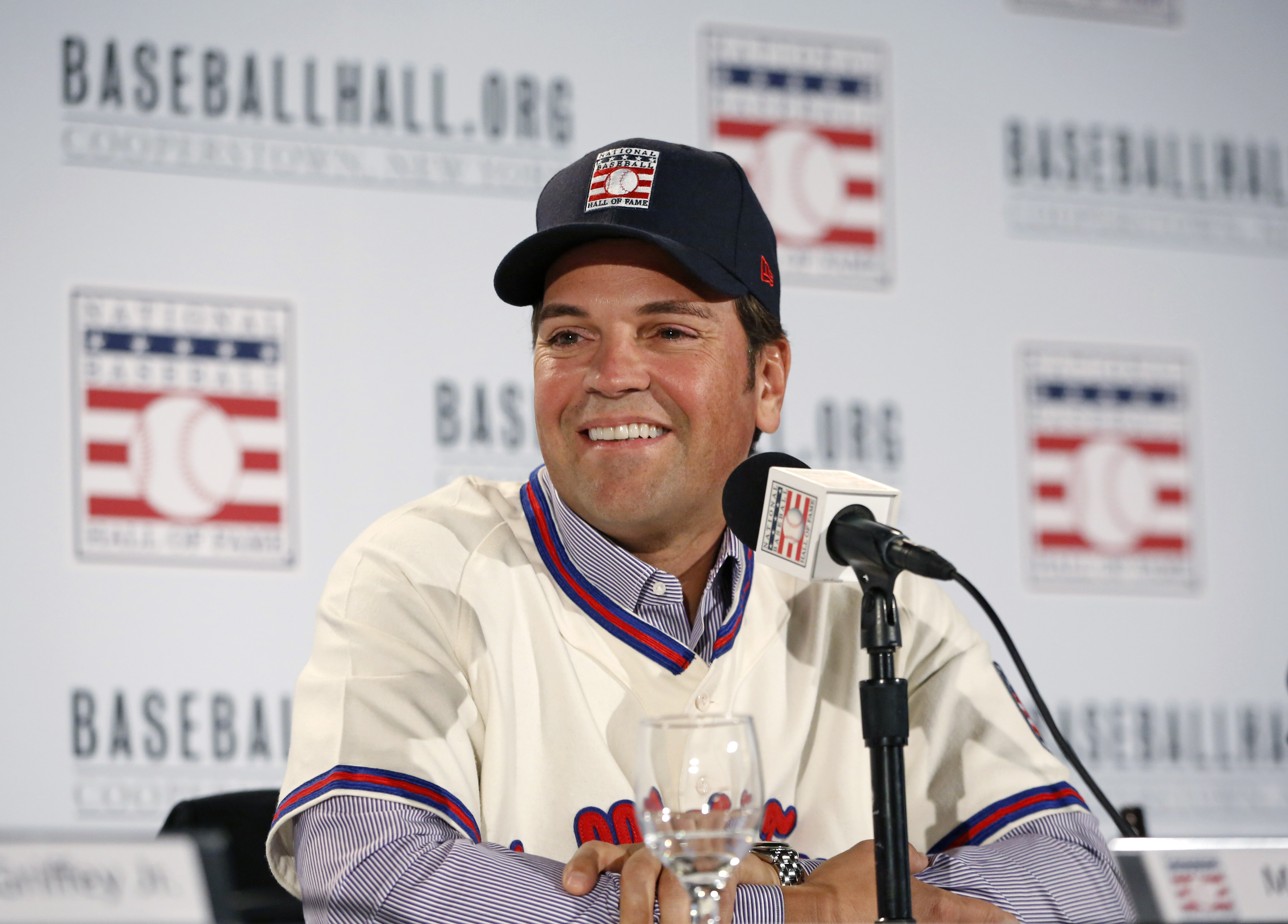 Retired New York Mets catcher Mike Piazza, smiles toward his family during at a press conference announcing his election to baseball's Hall of Fame, Thursday, Jan. 7, 2016, in New York. (AP Photo/Kathy Willens)