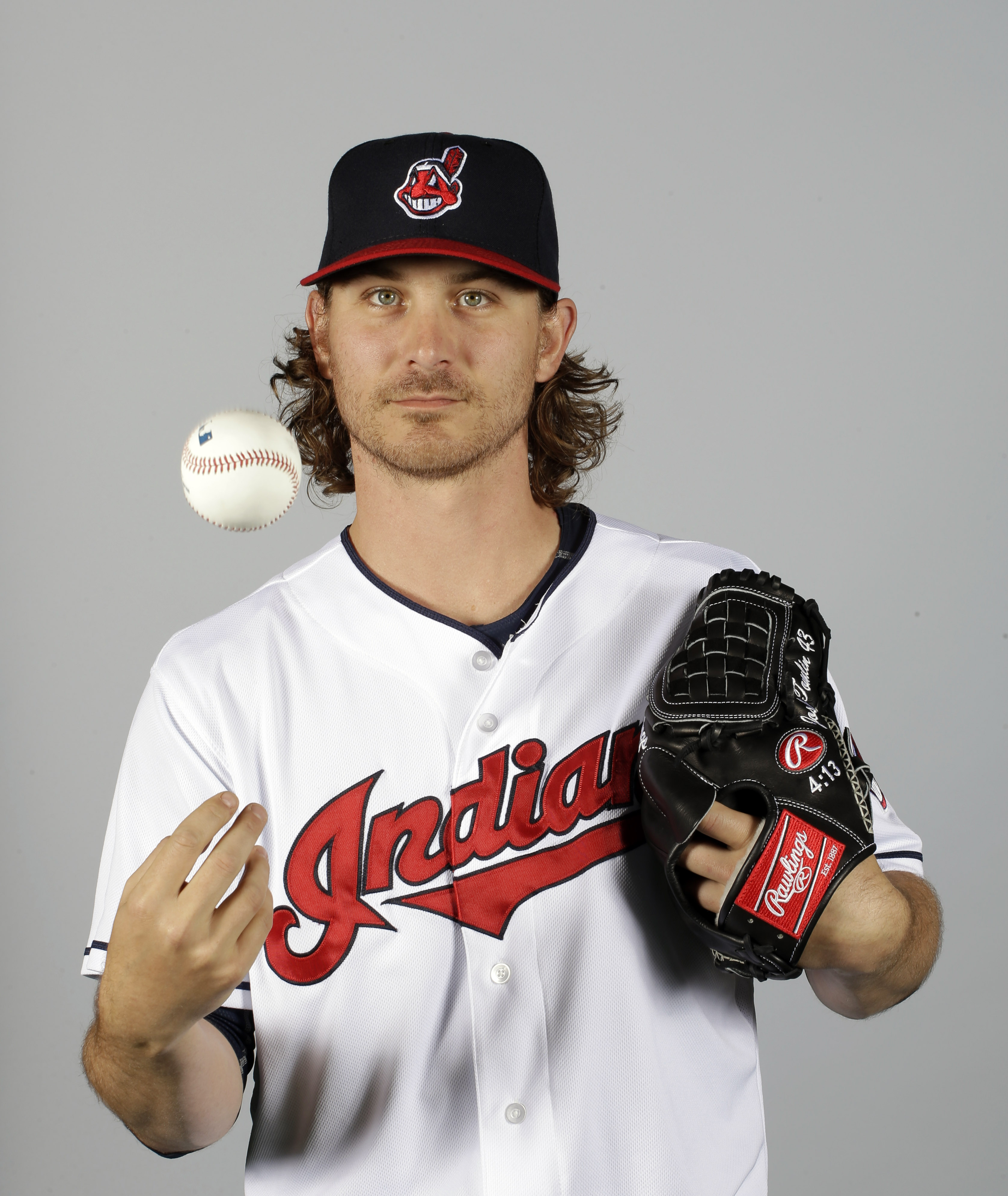 FILe - This is a 2015 file photo showing Josh Tomlin of the Cleveland Indians baseball team. Right-hander Josh Tomlin and the Cleveland Indians have agreed to a two-year contract, a deal that includes a club option for 2017. (AP Photo/Darron Cummings, Fil