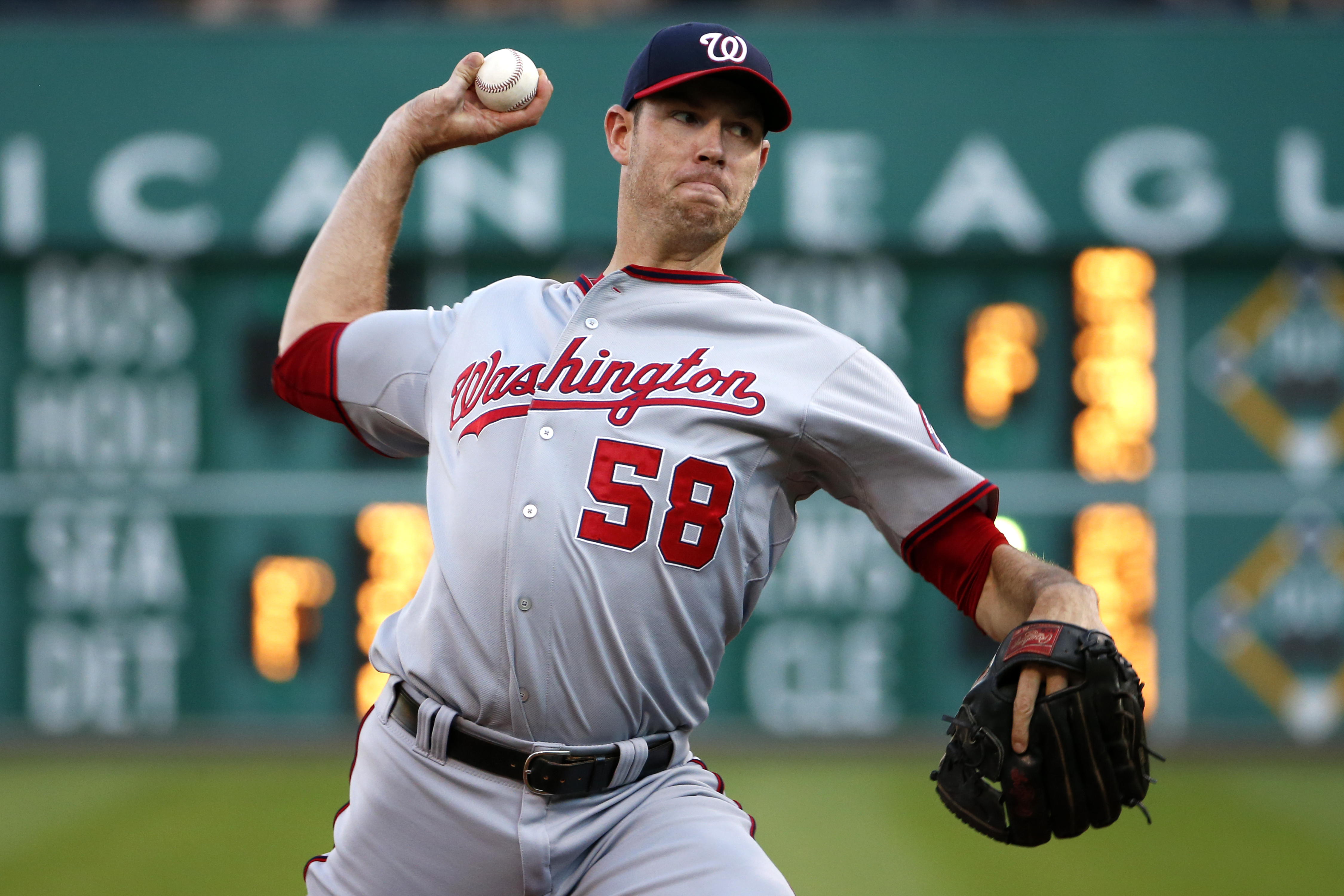 FILE - In this July 23, 2015, file photo, Washington Nationals starting pitcher Doug Fister (58) delivers in the first inning of a baseball game against the Pittsburgh Pirates in Pittsburgh. Right-hander Doug Fister and the Houston Astros have agreed to a