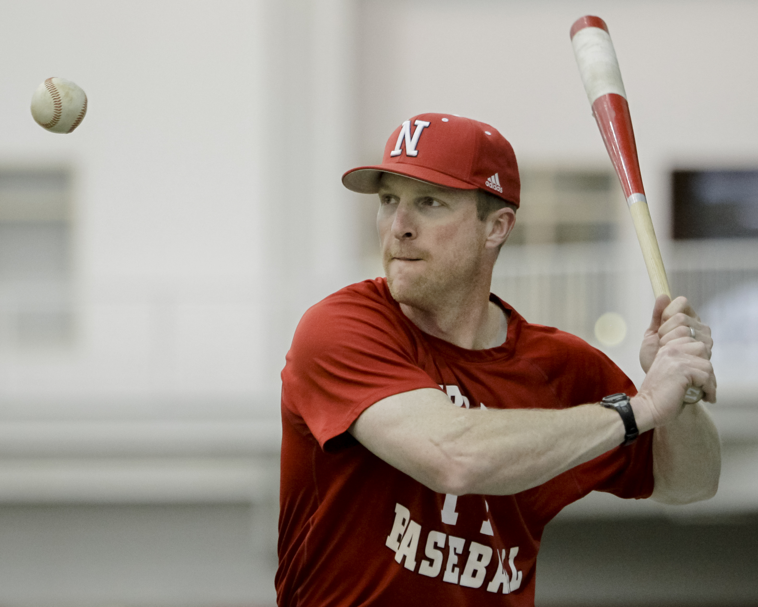 FILE - In this Feb. 28, 2012, file photo, Nebraska coach Darin Erstad hits balls during NCAA college baseball practice in Lincoln, Neb. A few days after Erstad interviewed for the Los Angeles Dodgers manager's job, he was working with a small group of his