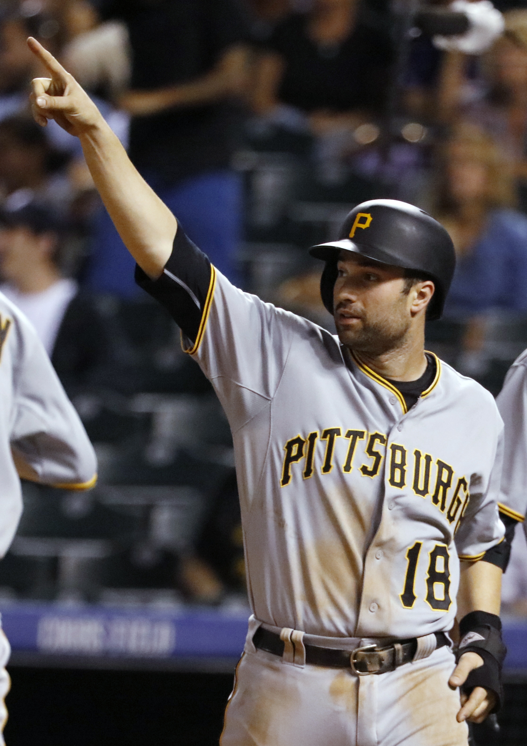 FILE - This Sept. 23, 2015 file photo shows Pittsburgh Pirates' Neil Walker gesturing to Sean Rodriguez after Rodriguez hit a three-run double against the Colorado Rockies during the ninth inning of a baseball game in Denver. The New York Mets have acquir