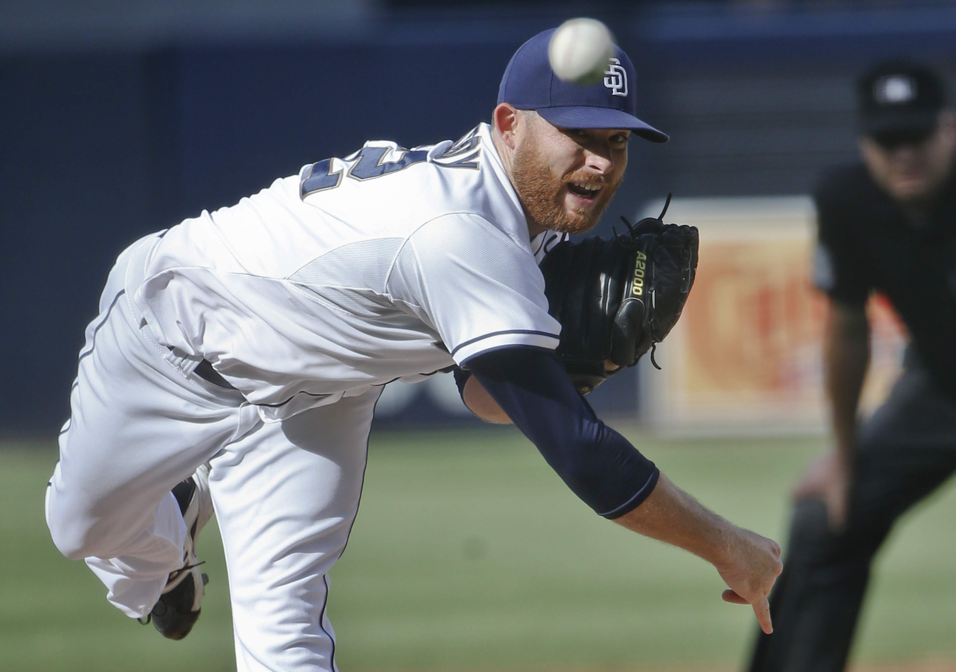 FILE - In this Oct. 1, 2015, file photo, San Diego Padres starting pitcher Ian Kennedy works against the Milwaukee Brewers in the first inning of a baseball game, in San Diego. The Kansas City Royals have announced their $70 million, five-year deal with K