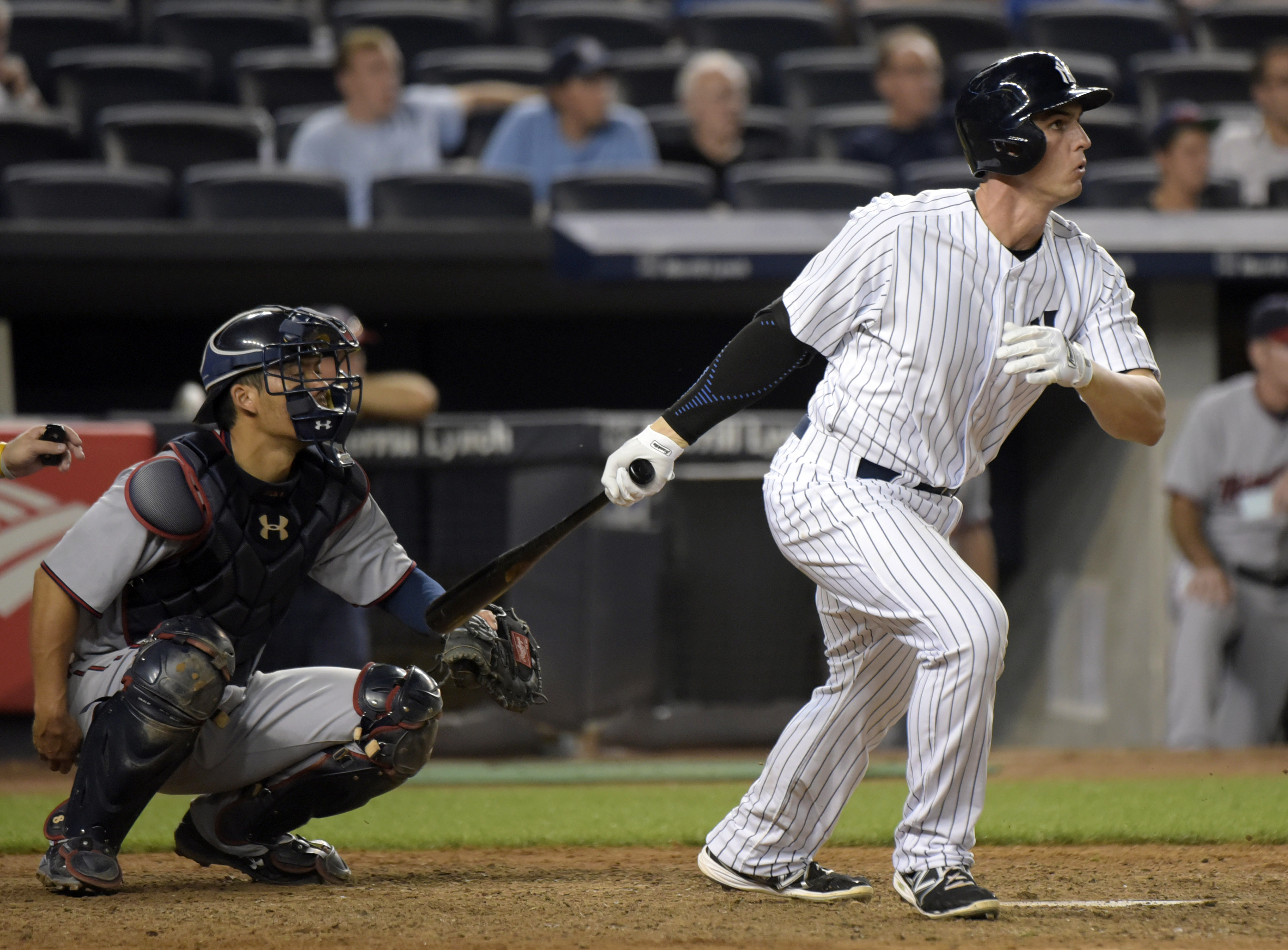 FILE - In this Aug. 17, 2015, file photo, New York Yankees' Greg Bird, right, hits a double as Minnesota Twins catcher Kurt Suzuki, left, looks on during the 10th inning of a baseball game in New York. Yankees first base prospect Bird will have right shou
