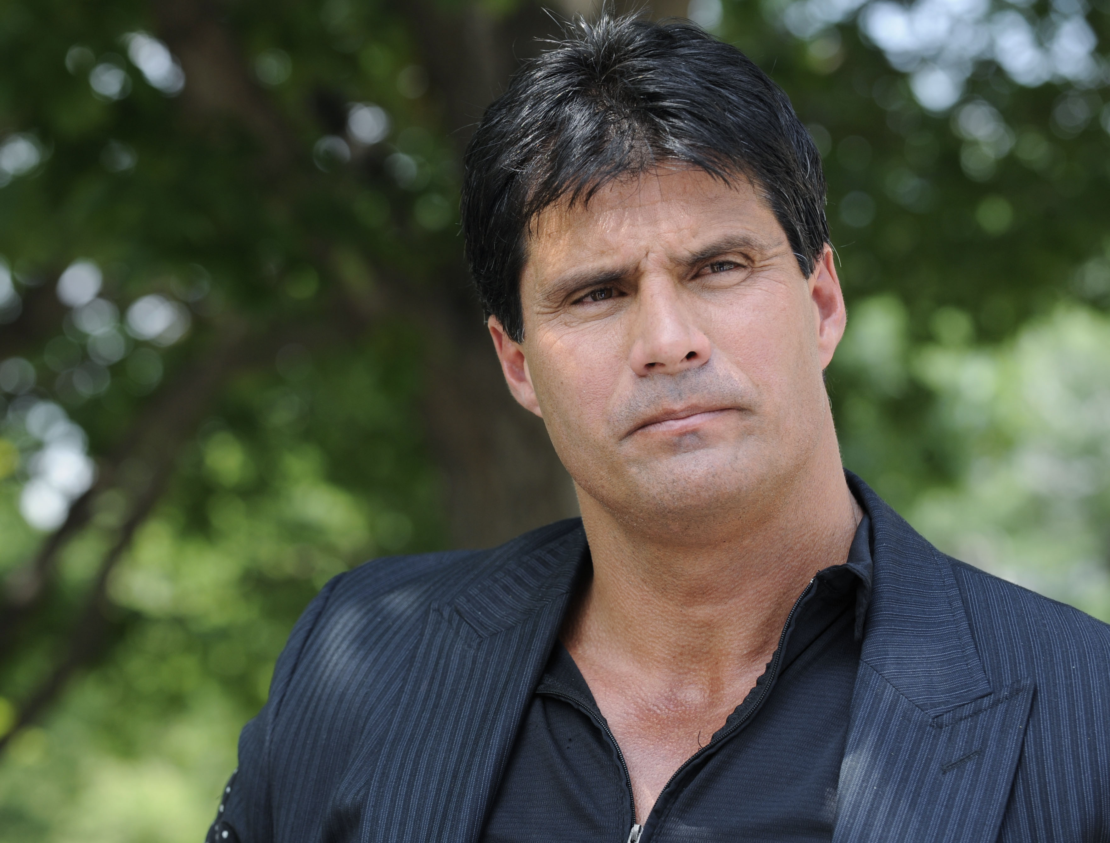 FILE - This June 3, 2010, file photo shows Jose Canseco talking with reporters in Washington. A Japanese economic plan has prompted Jose Canseco to jump into a whole new field, financial advice. he former slugging outfielder went on a Twitter rant late We