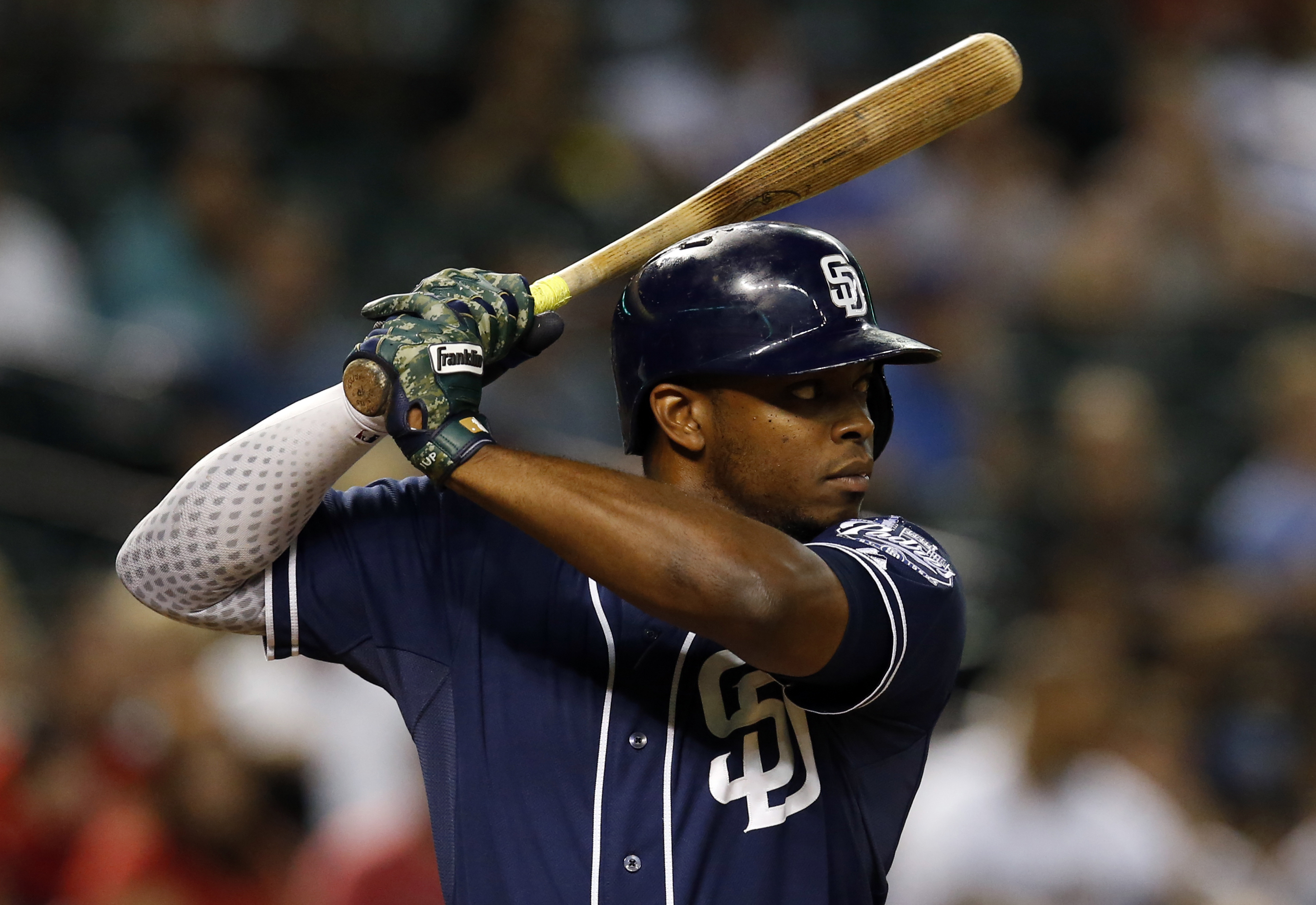 FILE- In this Sept. 15, 2015, file photo, San Diego Padres left fielder Justin Upton looks to hit in the sixth inning of a baseball game against the Arizona Diamondbacks in Phoenix. Upton is among the top players to join the AL Central. (AP Photo/Rick Scu