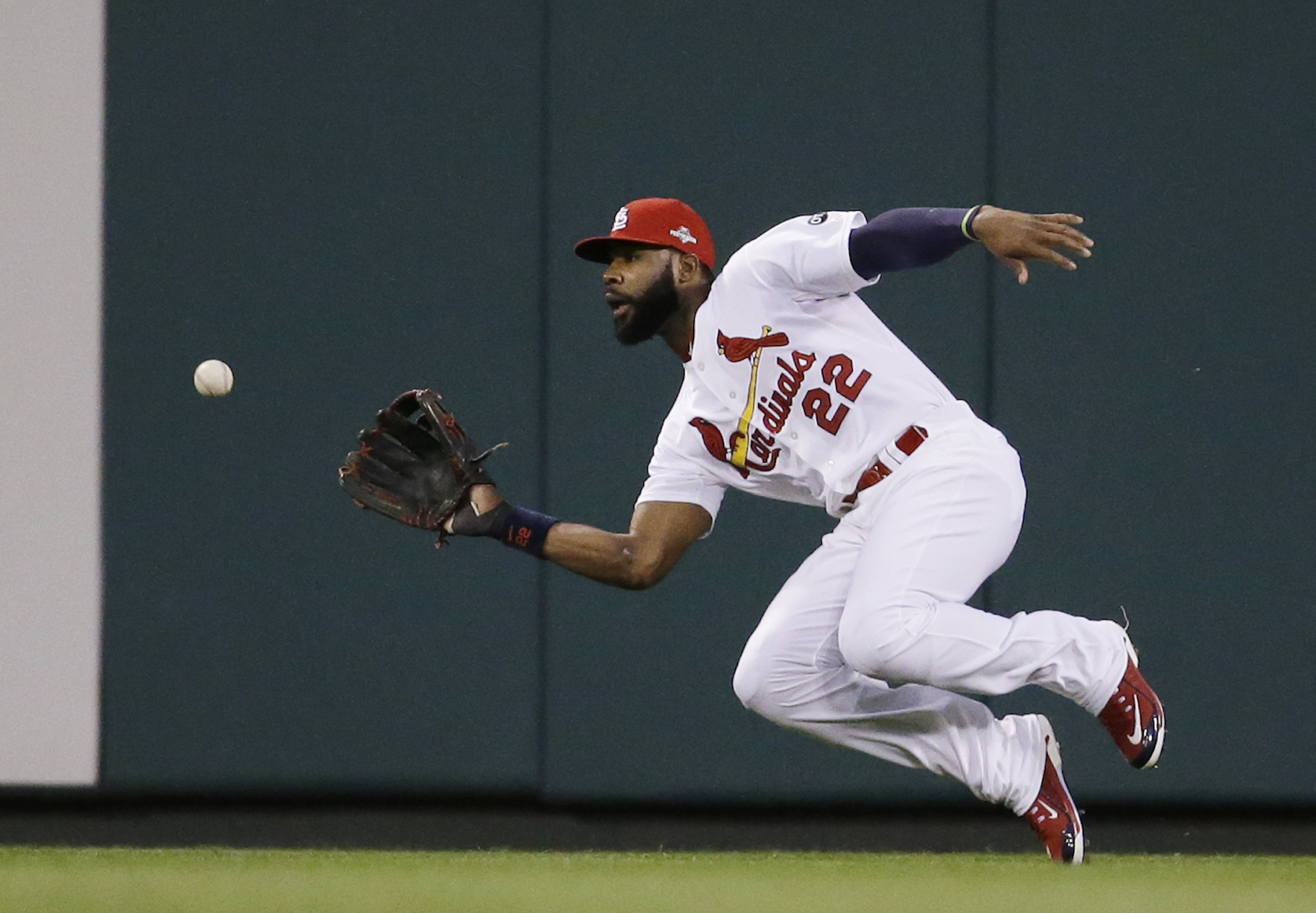 FILE - In this Oct. 9, 2015, file photo, St. Louis Cardinals right fielder Jason Heyward prepares to catch a ball hit by Chicago Cubs' Addison Russell during the third inning of Game 1 in baseball's National League Division Series in St. Louis. Heyward is