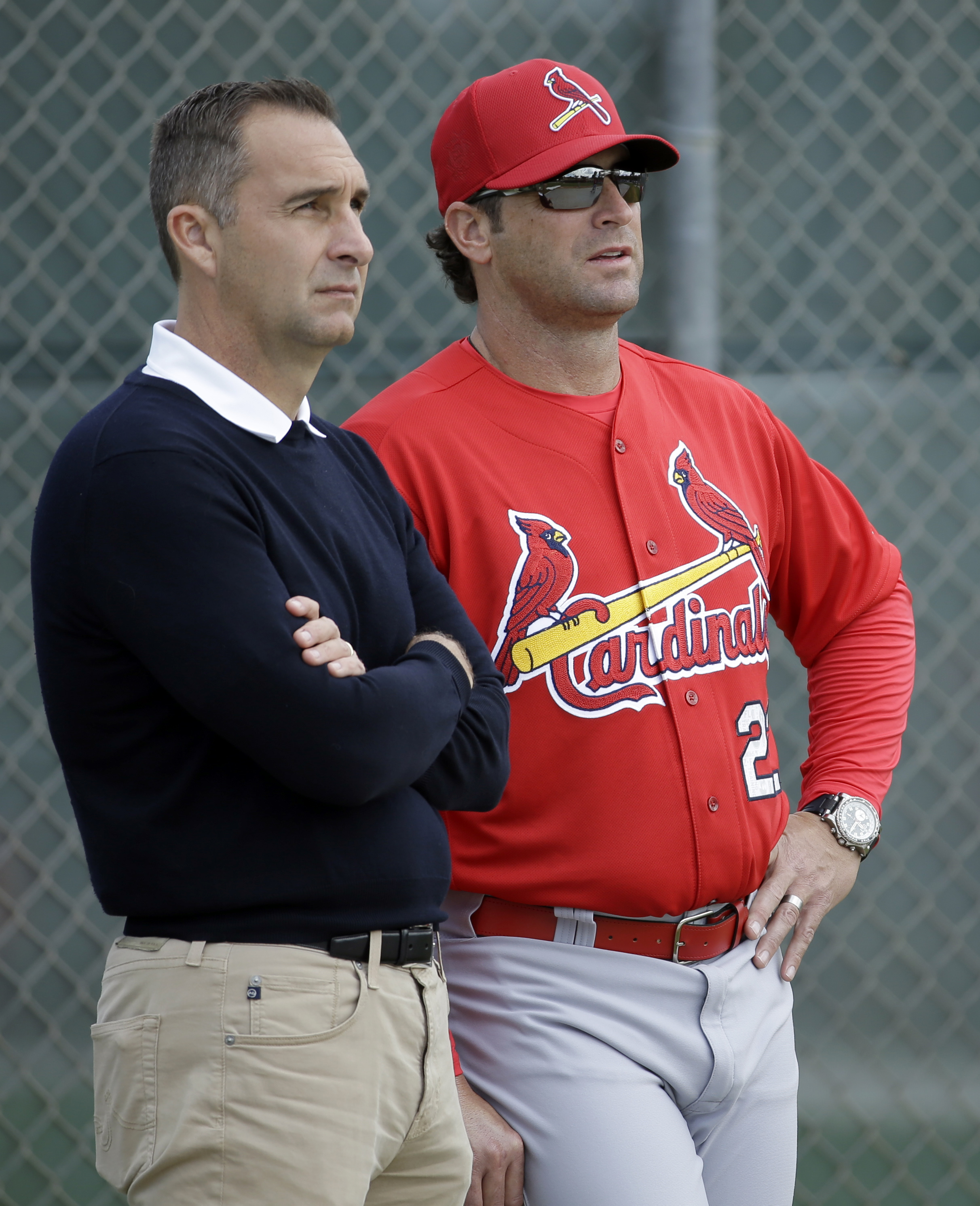 St. Louis Cardinals general manager John Mozeliak, left, and manager Mike Matheny watch pitchers throw in the bullpen during spring training baseball practice Thursday, Feb. 18, 2016, in Jupiter, Fla. (AP Photo/Jeff Roberson)