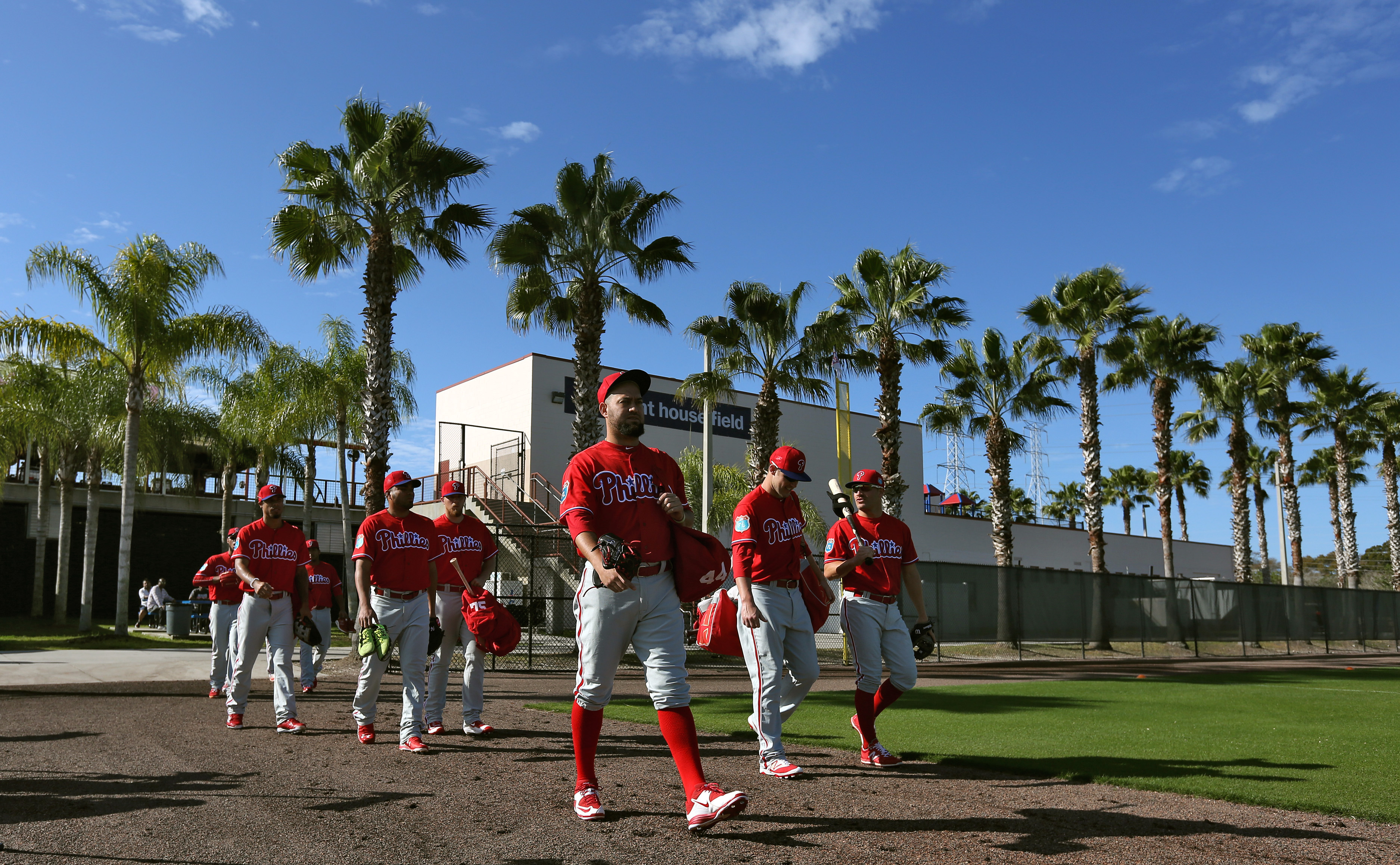 Philadelphia Phillies players head for the field and a spring training baseball workout Sunday, Feb. 21, 2016, in Clearwater, Fla. (AP Photo/Chris O'Meara)
