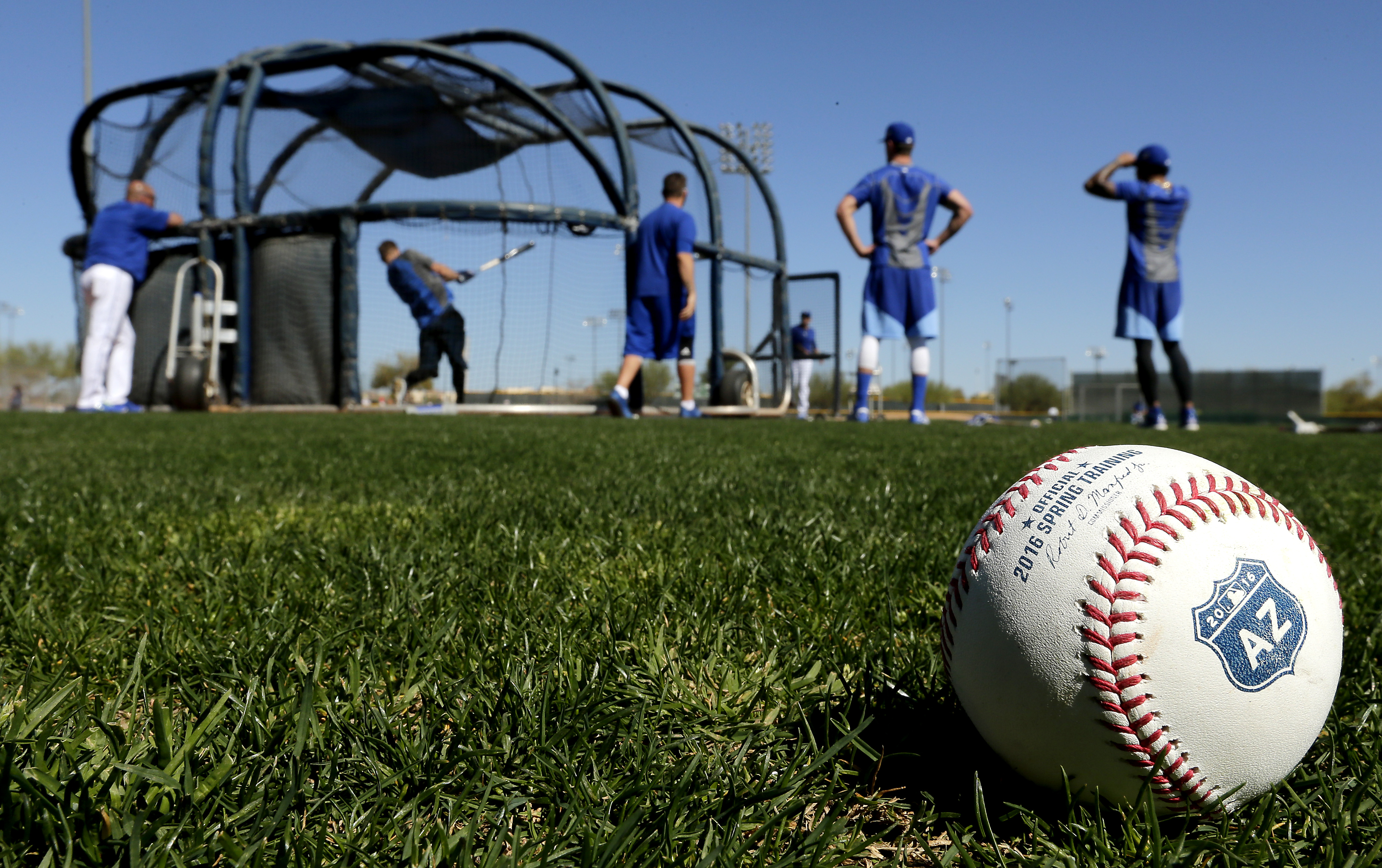 Players for the Kansas City Royals have batting practice during spring training baseball practice Sunday, Feb. 21, 2016, in Surprise, Ariz. (AP Photo/Charlie Riedel)