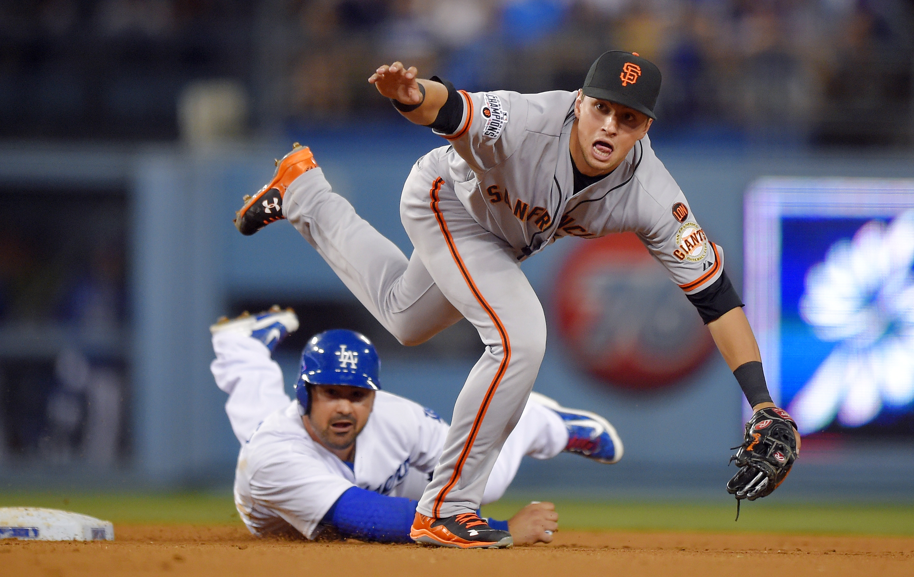 FILE - In this April 29, 2015 file photo, Los Angeles Dodgers' Adrian Gonzalez is forced out at second as San Francisco Giants second baseman Joe Panik throws to first in baseball game in Los Angeles. With his troublesome back healthy and pain-free at las