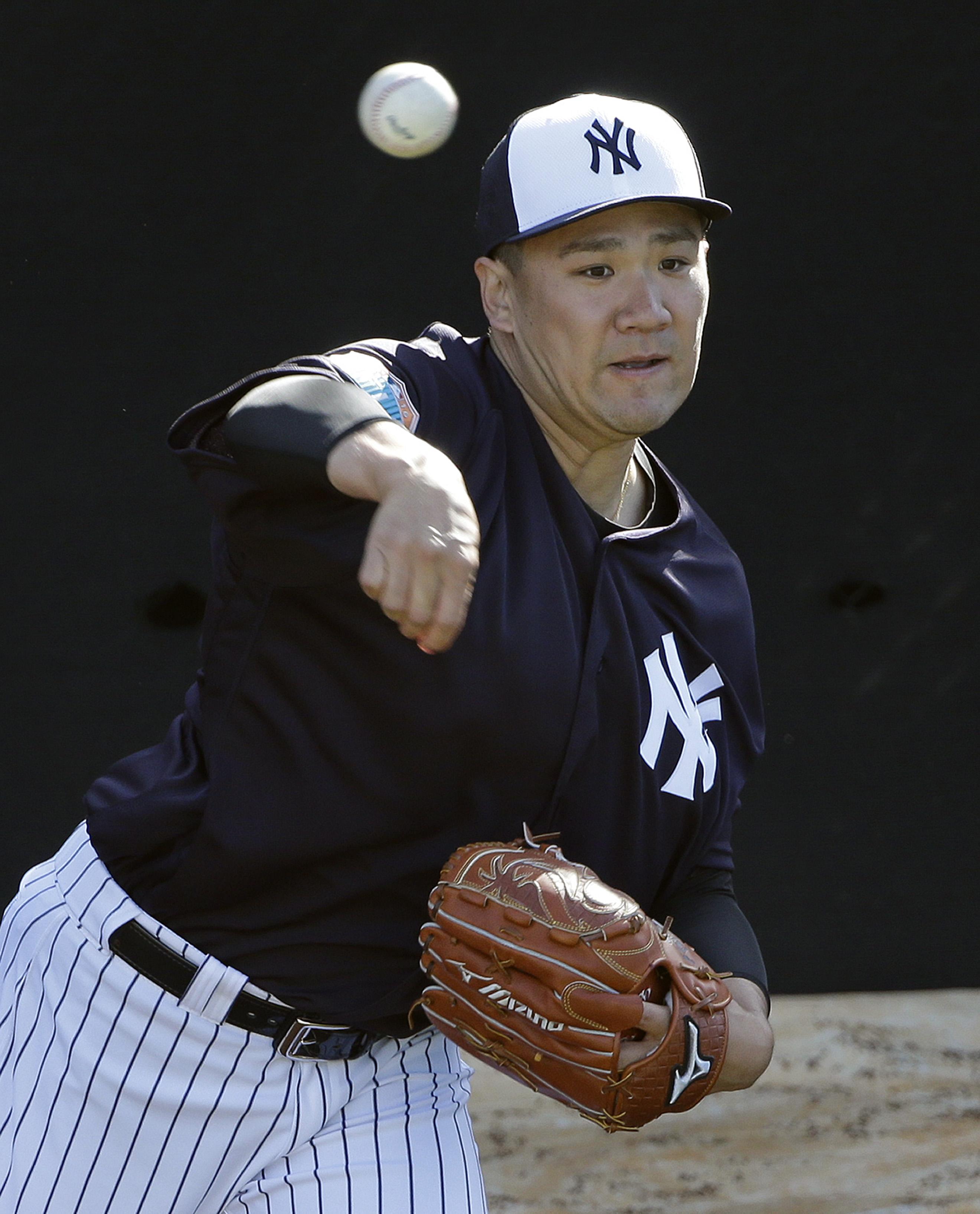 New York Yankees pitcher Masahiro Tanaka, of Japan, throws a bullpen session during a spring training baseball workout Monday, Feb. 22, 2016, in Tampa, Fla. (AP Photo/Chris O'Meara)