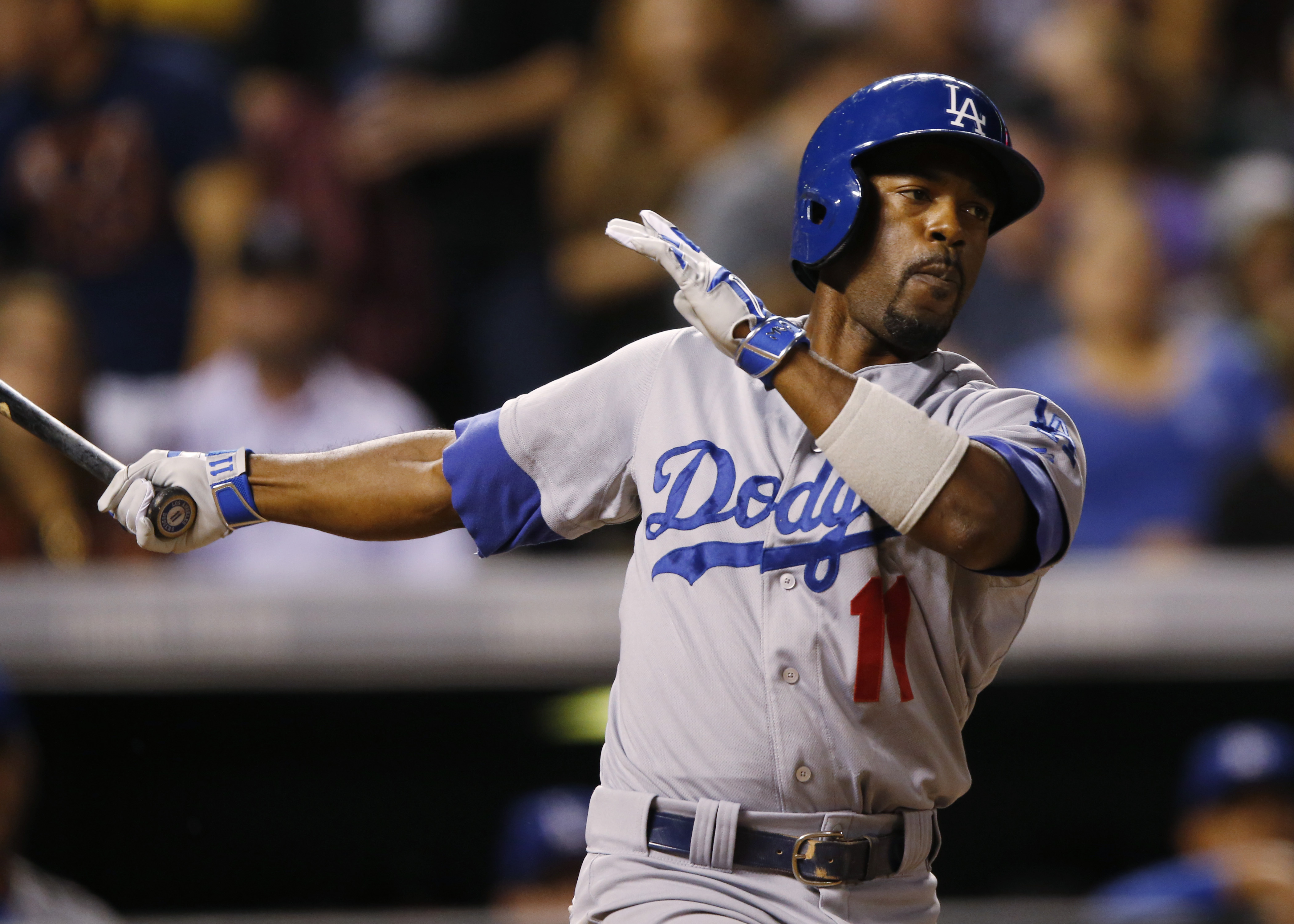 FILE - In this Sept. 25, 2015, file photo, Los Angeles Dodgers shortstop Jimmy Rollins (11) bats against the Colorado Rockies in the fifth inning of a baseball game, in Denver. Former National League MVP Jimmy Rollins agreed Monday, Feb. 22, 2016,  to a m