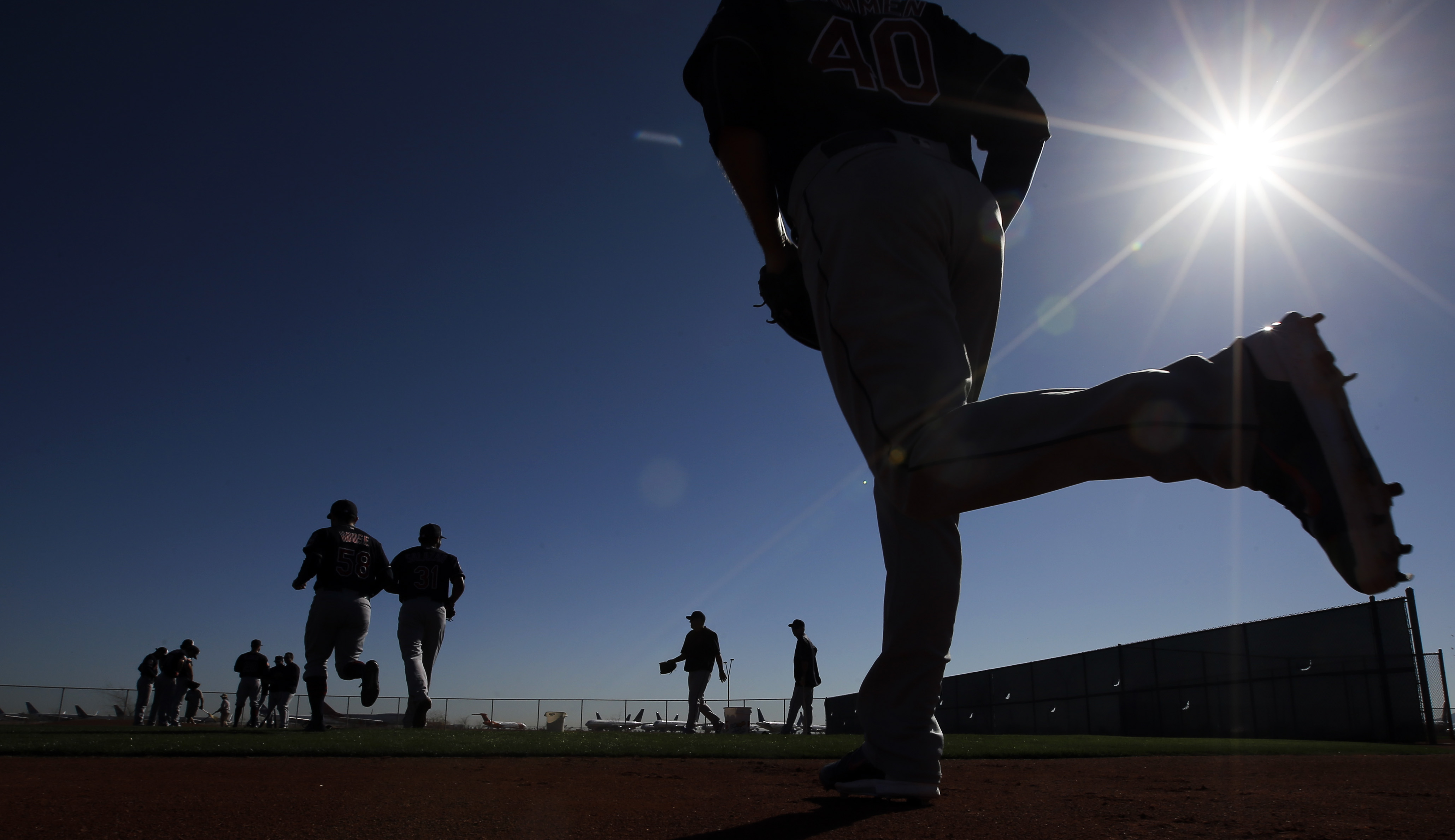Cleveland Indians players make their way to a practice field for a spring training baseball workout Monday, Feb. 22, 2016, in Goodyear, Ariz. (AP Photo/Morry Gash)
