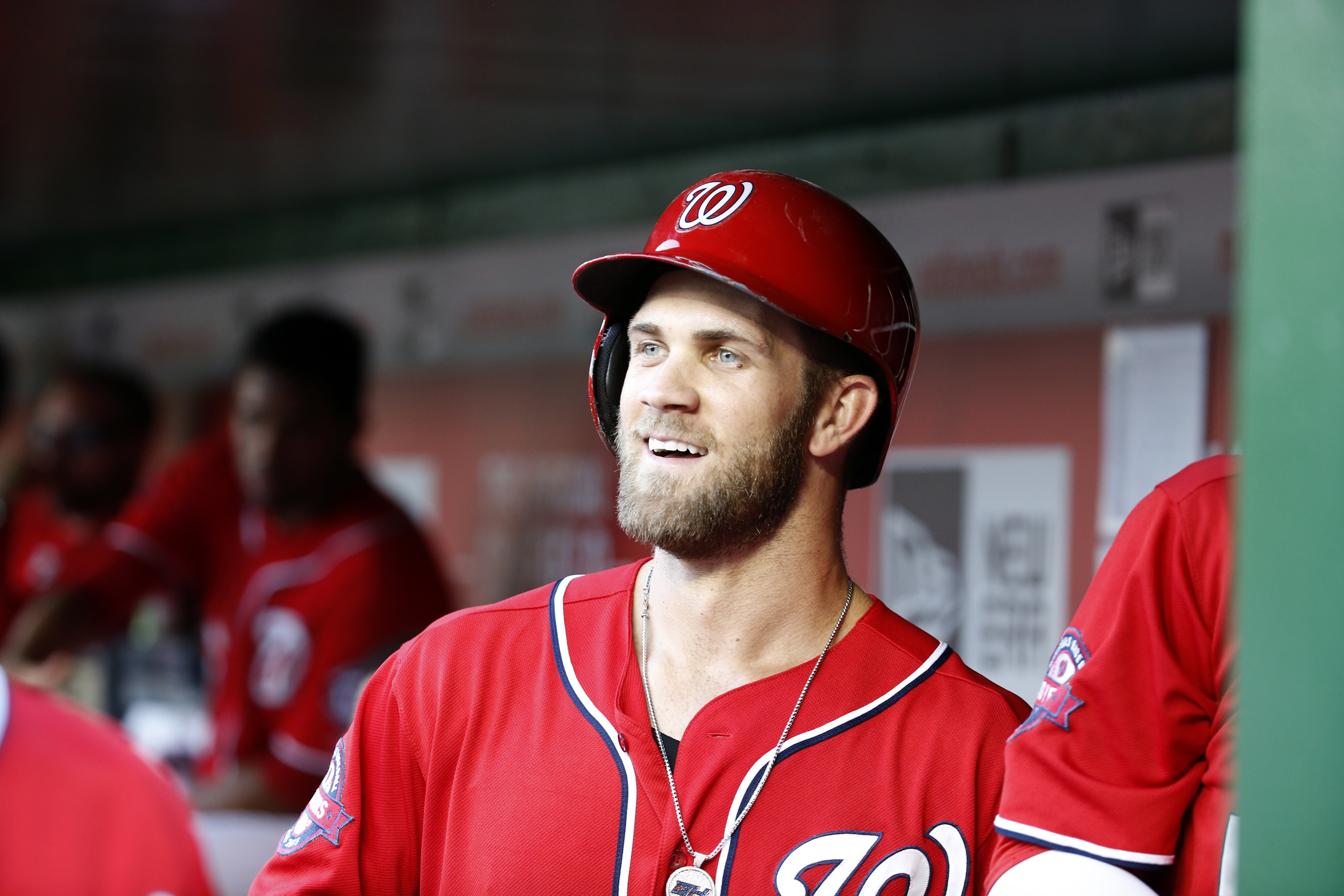 In this photo taken Sept. 19, 2015, Washington Nationals right fielder Bryce Harper (34) smiles in the dugout after hitting a two-run homer during a baseball game against the Miami Marlins at Nationals Park in Washington. Harper is a lot of things, namely