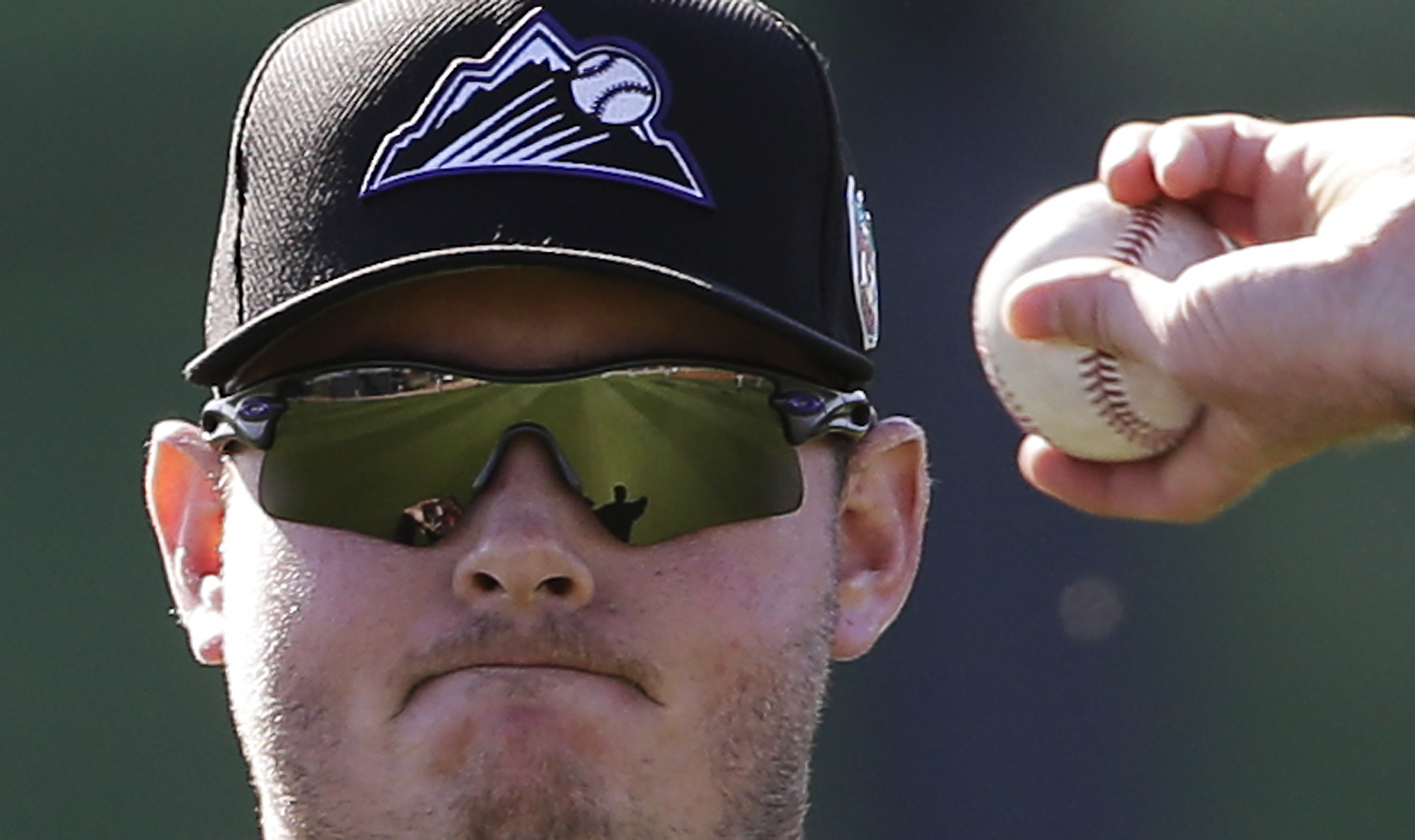 Colorado Rockies starting pitcher Tyler Matzek throws during spring training baseball practice in Scottsdale, Ariz., Monday, Feb. 22, 2016. (AP Photo/Chris Carlson)