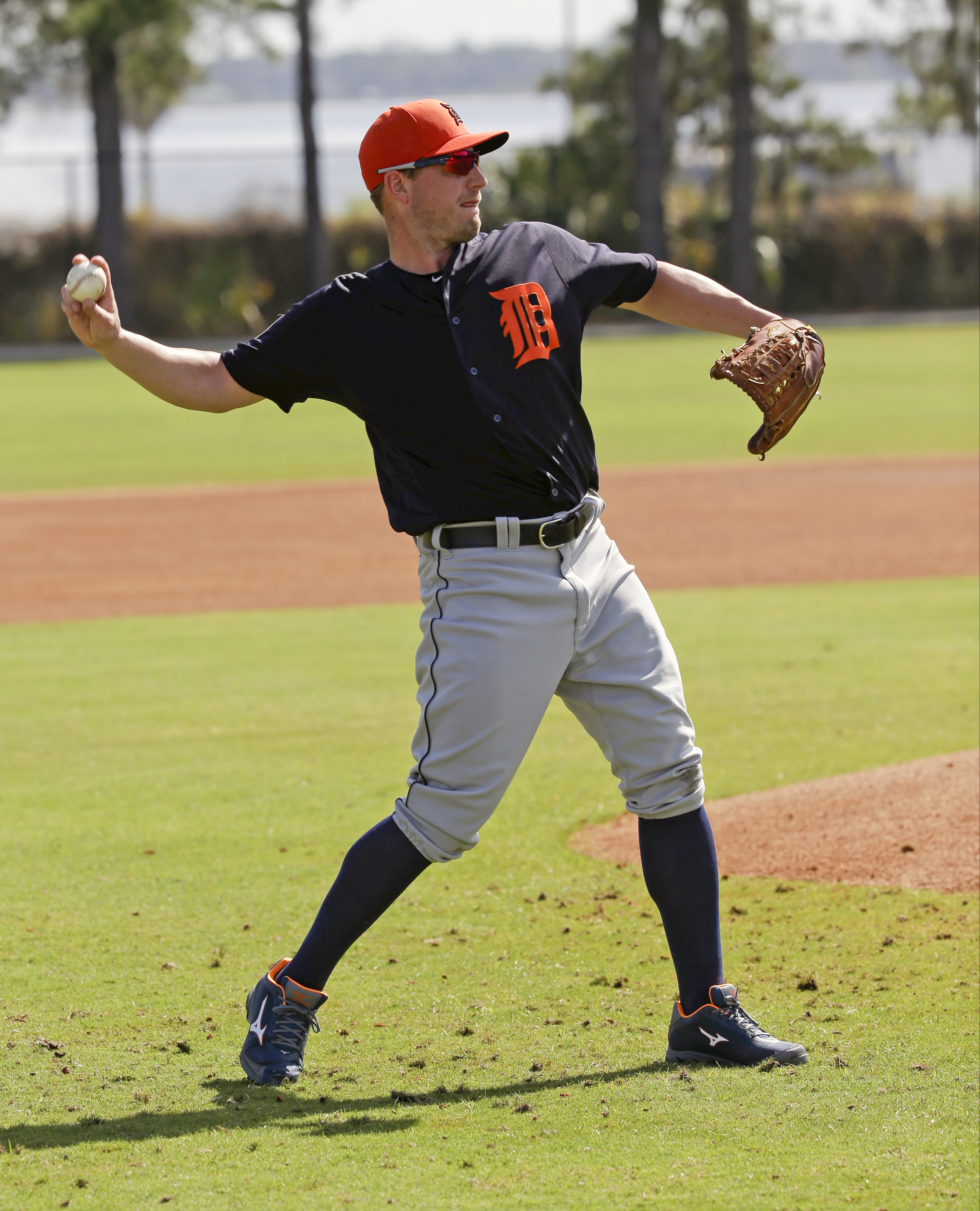 Detroit Tigers starting pitcher Jordan Zimmermann throws to first base during a drill at a spring training baseball workout, Monday, Feb. 22, 2016, in Lakeland, Fla. (AP Photo/John Raoux)