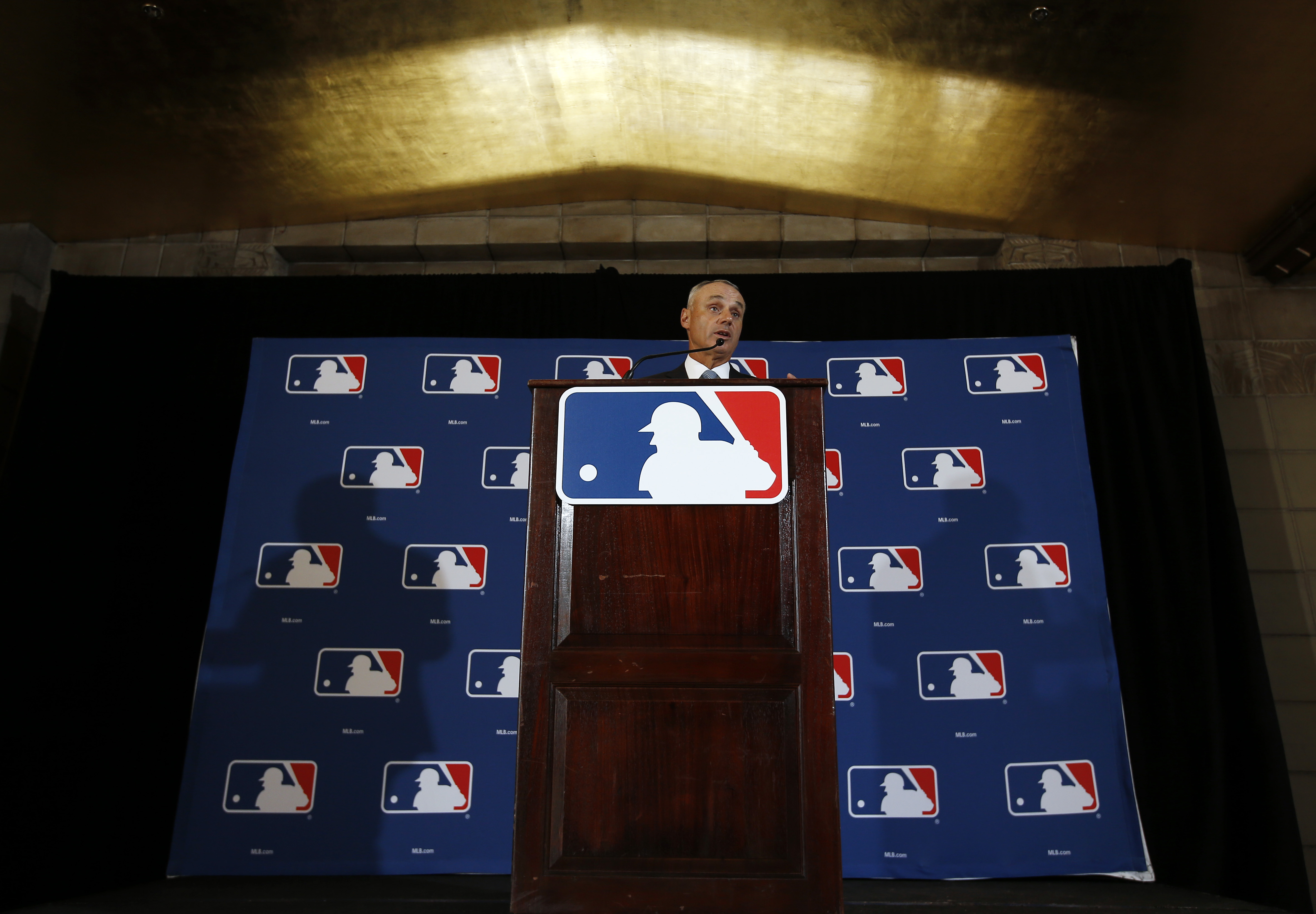 Major League Baseball Commissioner Rob Manfred answers a question during a news conference Monday, Feb. 22, 2016, in Phoenix. (AP Photo/Morry Gash)