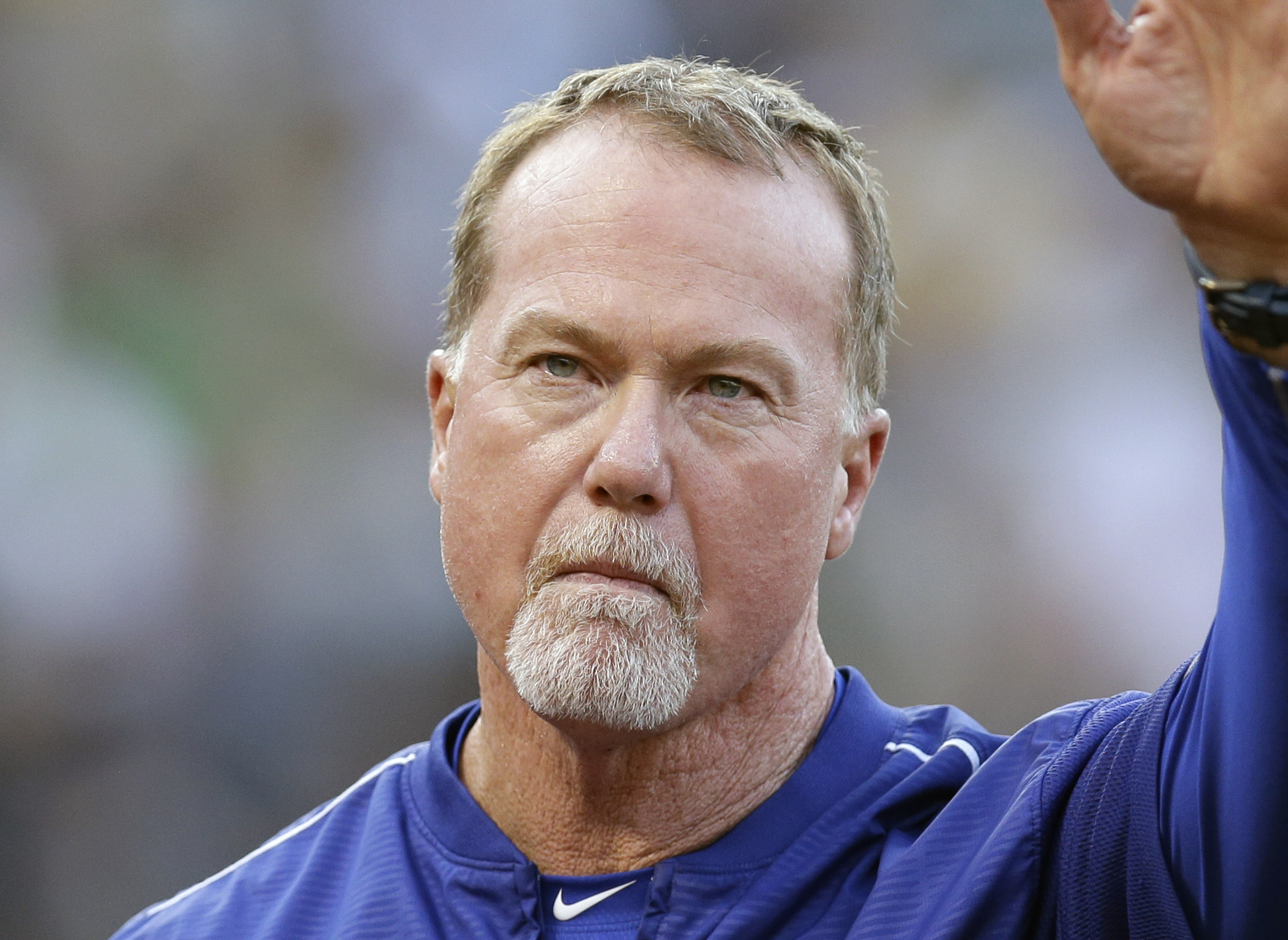FILE - In this Aug. 18, 2015, file photo, then-Los Angeles Dodgers hitting coach Mark McGwire is shown prior to a baseball game against the Oakland Athletics, in Oakland, Calif. New Padres bench coach Mark McGwire is absent from spring training while he t