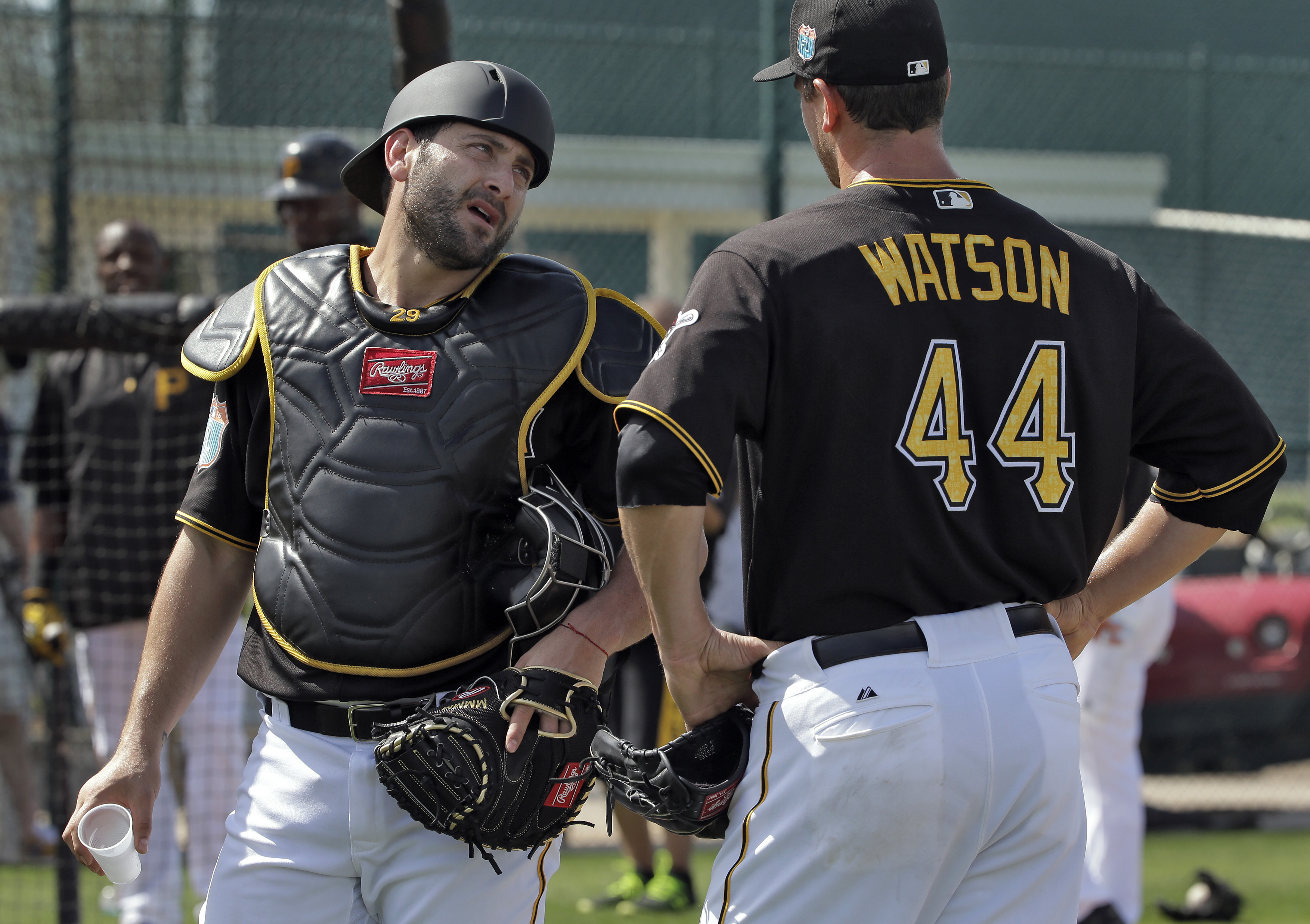 Pittsburgh Pirates catcher Francisco Cervelli, left, talks to relief pitcher Tony Watson after throwing live batting practice during a spring training baseball workout Tuesday, Feb. 23, 2016, in Bradenton, Fla. (AP Photo/Chris O'Meara)