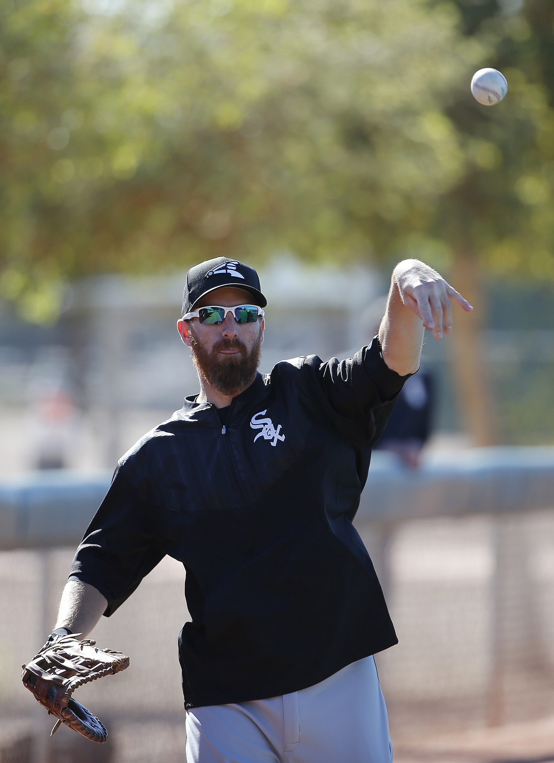 Chicago White Sox's Adam LaRoche warms up during a spring training baseball workout Wednesday, Feb. 24, 2016, in Glendale, Ariz. (AP Photo/Ross D. Franklin)