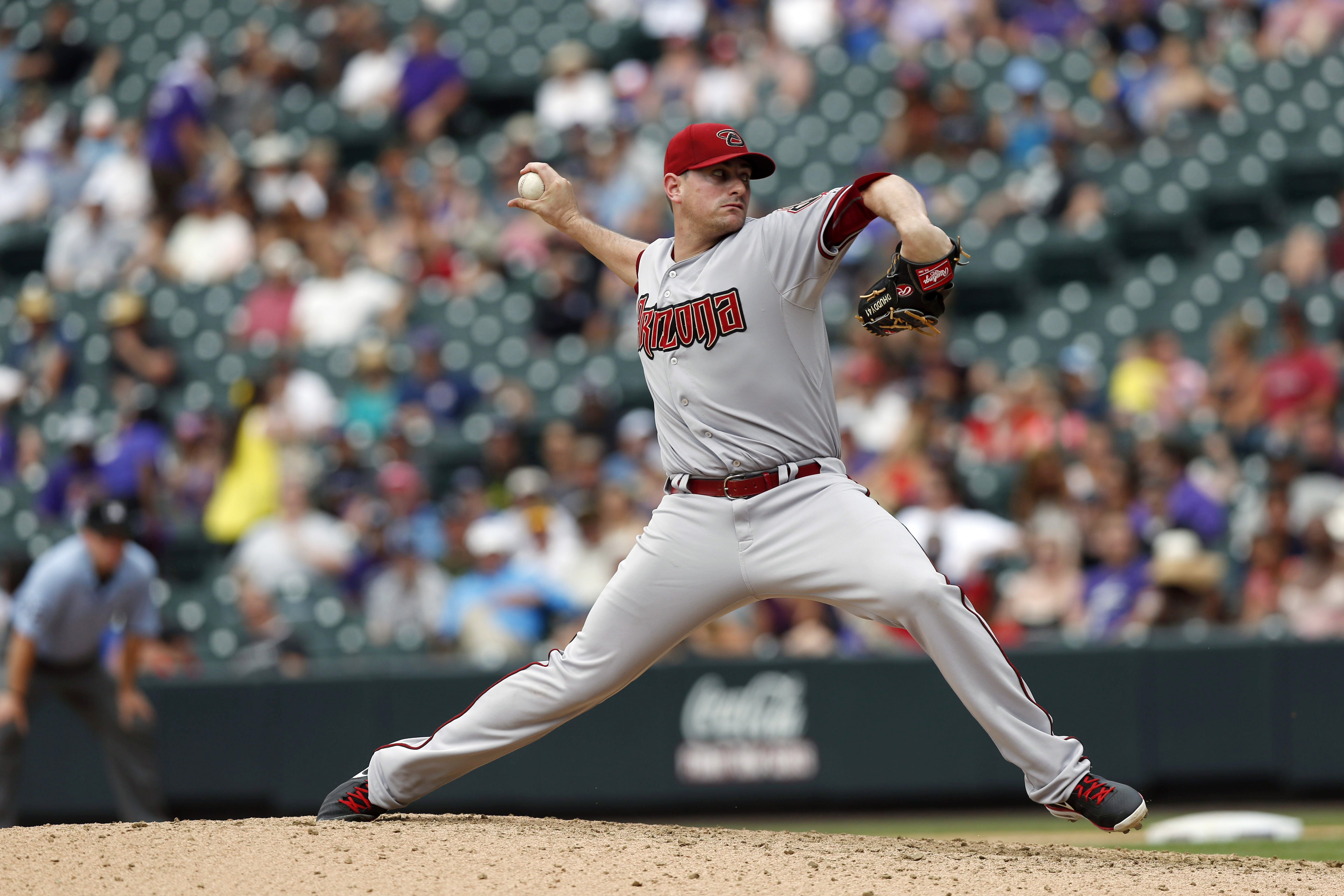 FILE - In this June 25, 2015, file photo, Arizona Diamondbacks relief pitcher Daniel Hudson (41) works against the Colorado Rockies in the eighth inning of a baseball game, in Denver. After two Tommy John surgeries, 2015 was a season of triumph for Daniel