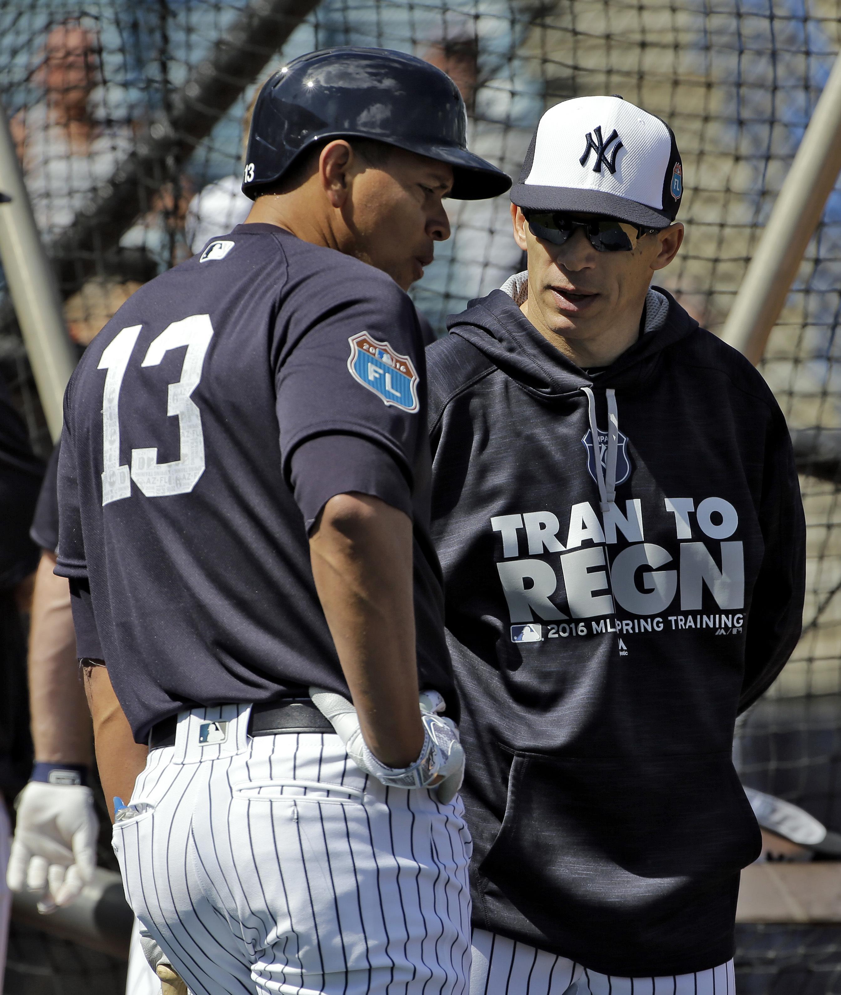 New York Yankees Joe Girardi, right, talks to Alex Rodriguez during a spring training baseball workout Thursday, Feb. 25, 2016, in Tampa, Fla. (AP Photo/Chris O'Meara)