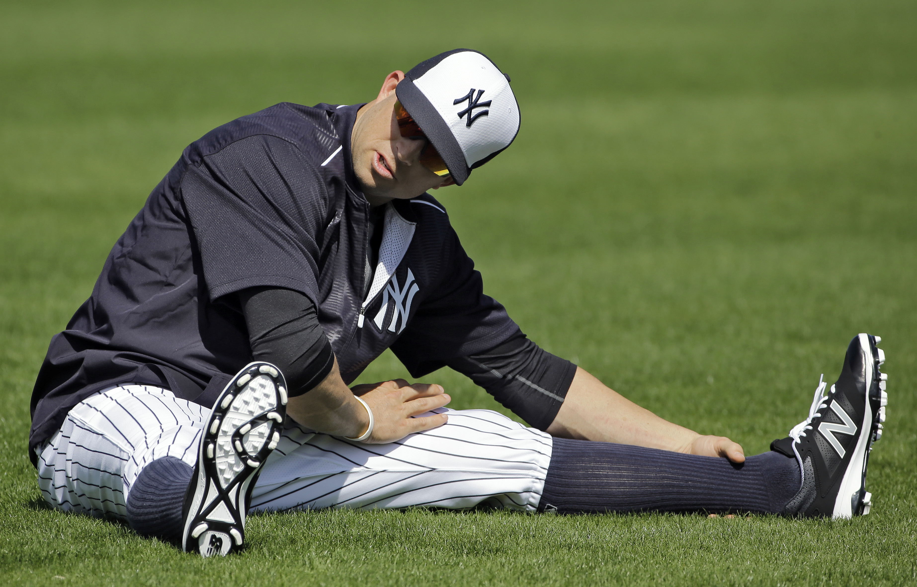 New York Yankees Brett Gardner stretches during a spring training baseball workout Thursday, Feb. 25, 2016, in Tampa, Fla. (AP Photo/Chris O'Meara)