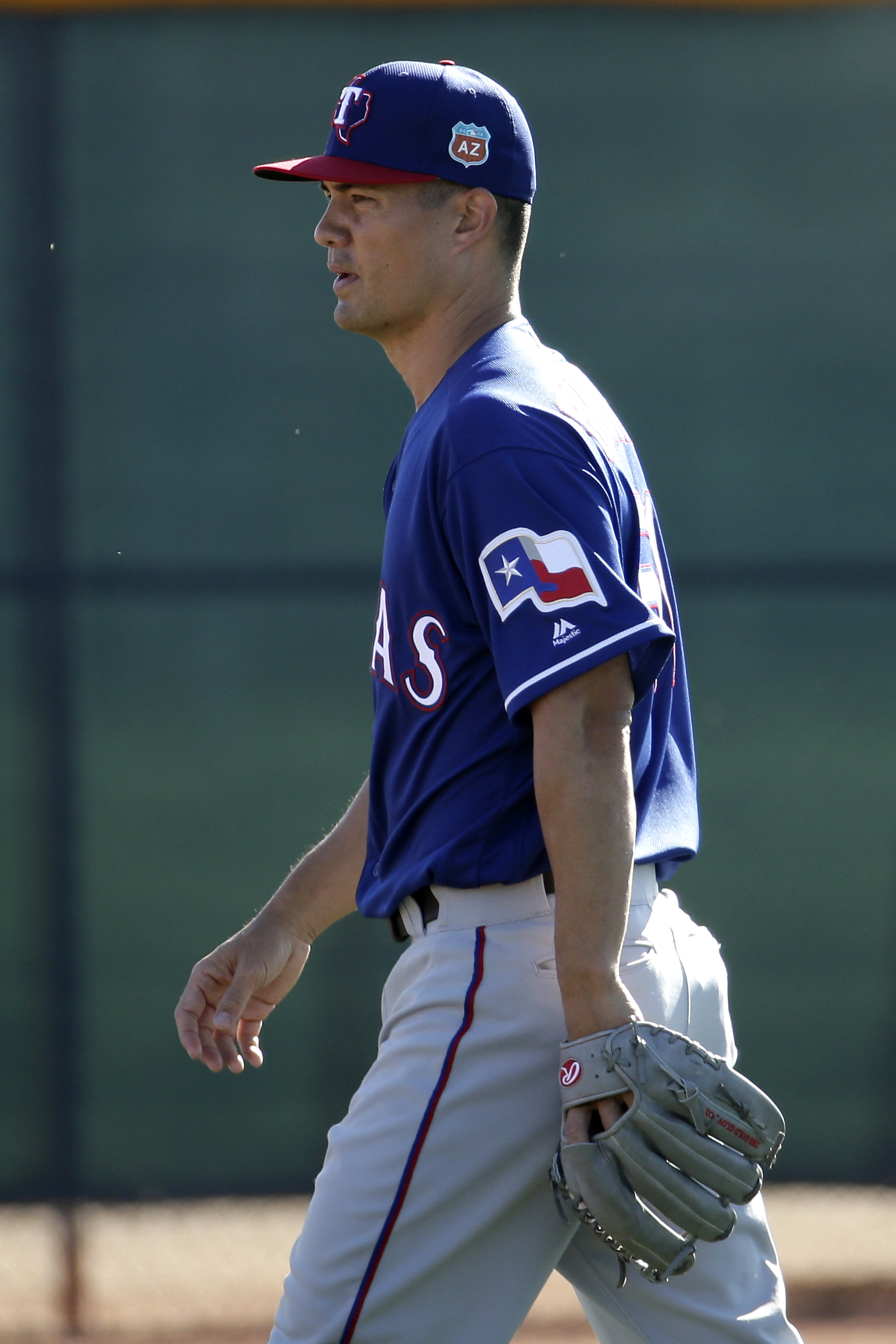 FILE - In this Feb. 21, 2016, file photo, Texas Rangers pitcher Jeremy Guthrie walks between drills during spring training baseball practice, in Surprise, Ariz. Jeremy Guthrie knows that feeling of things being the same but different. The right-hander is