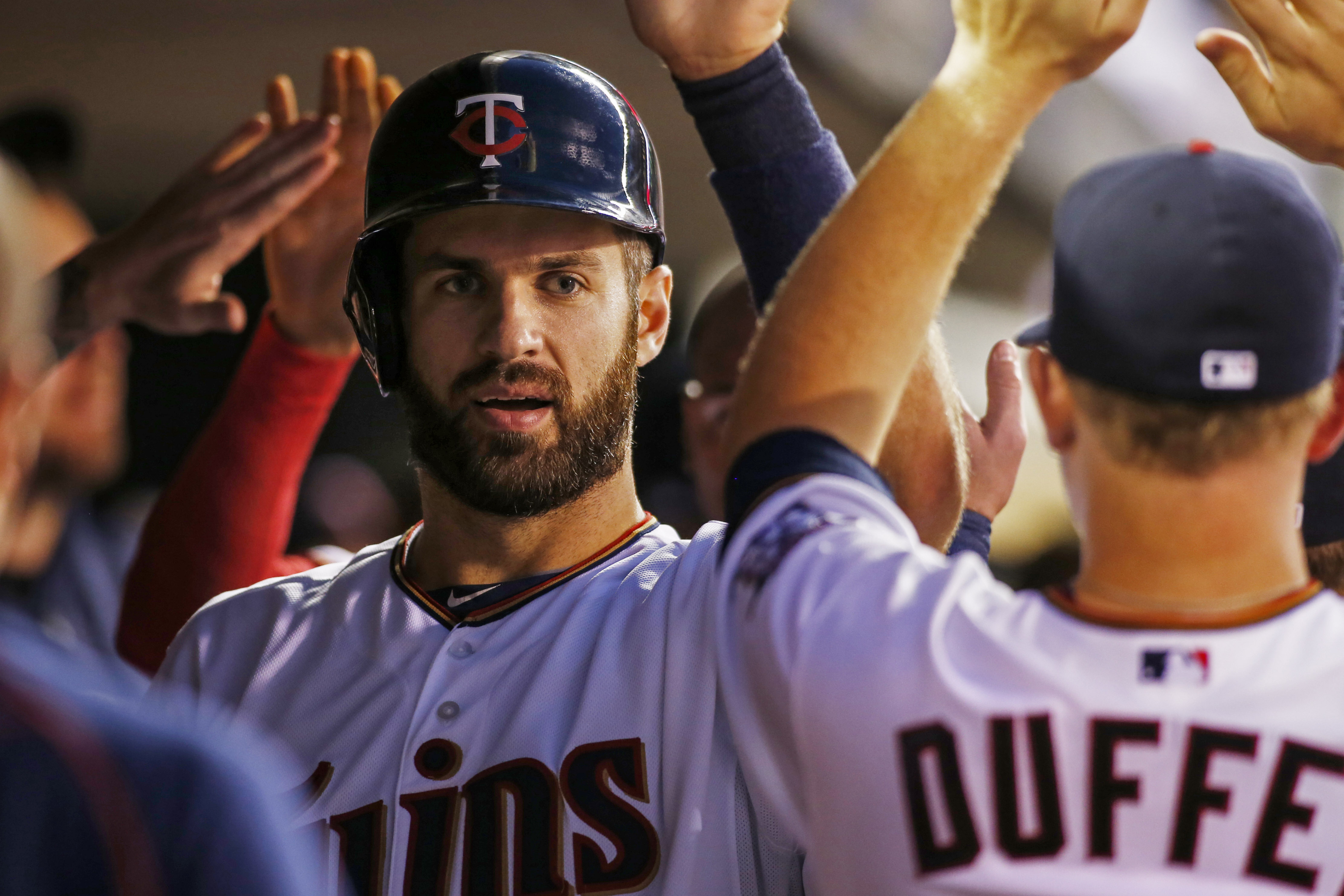 FILE - In this Sept. 14, 2015, file photo, Minnesota Twins first baseman Joe Mauer (7) celebrates his run against the Detroit Tigers in the first inning of a baseball game, in Minneapolis. Joe Mauer hasn't been the same since his concussion in 2013 forced